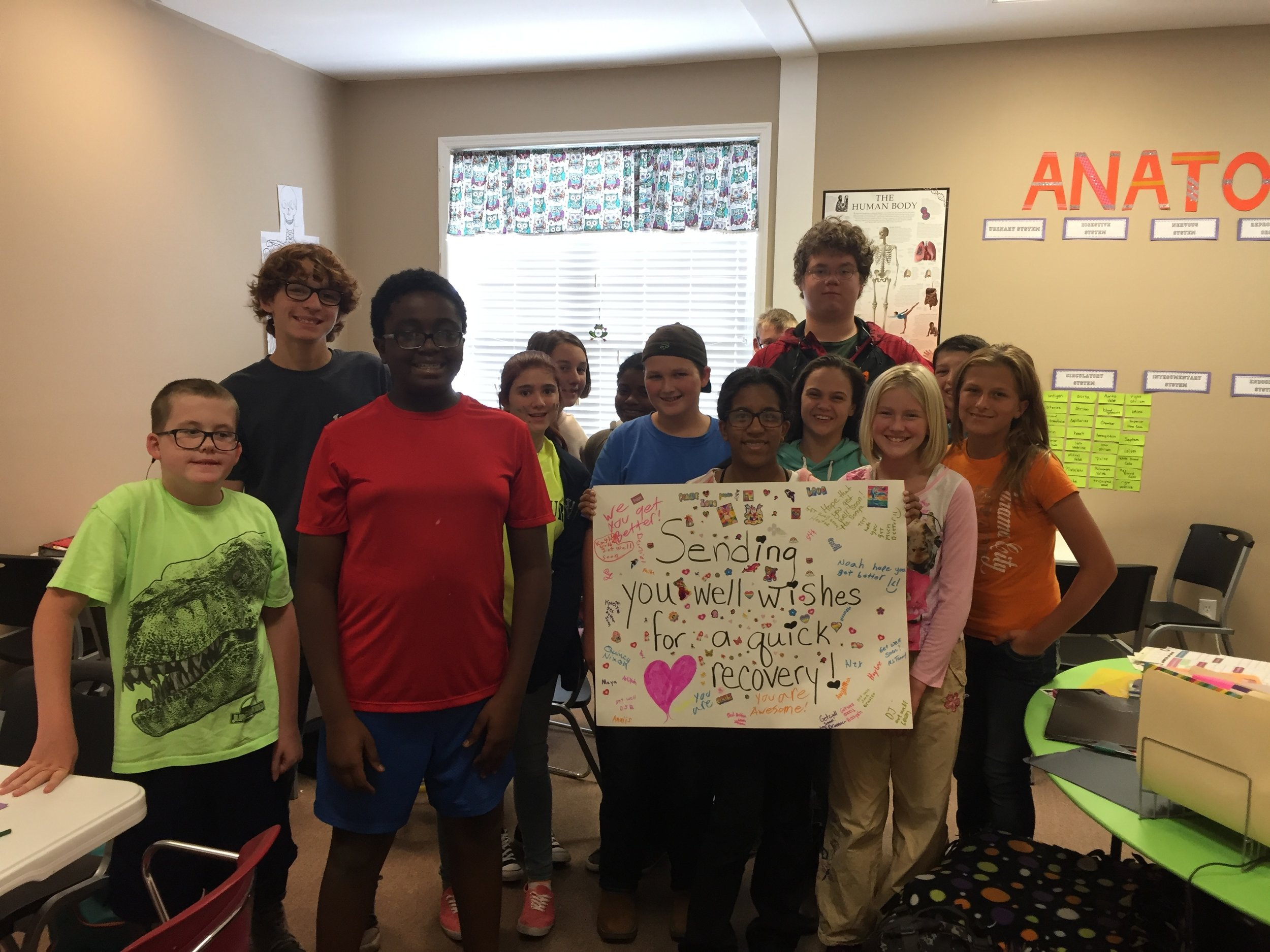 Students made a get well card for the mother of one of their classmate's who had to undergo surgery.