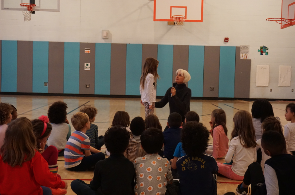 Marie Christine Giordano engaging a young student at PS133 during the lecture for K-1st grade