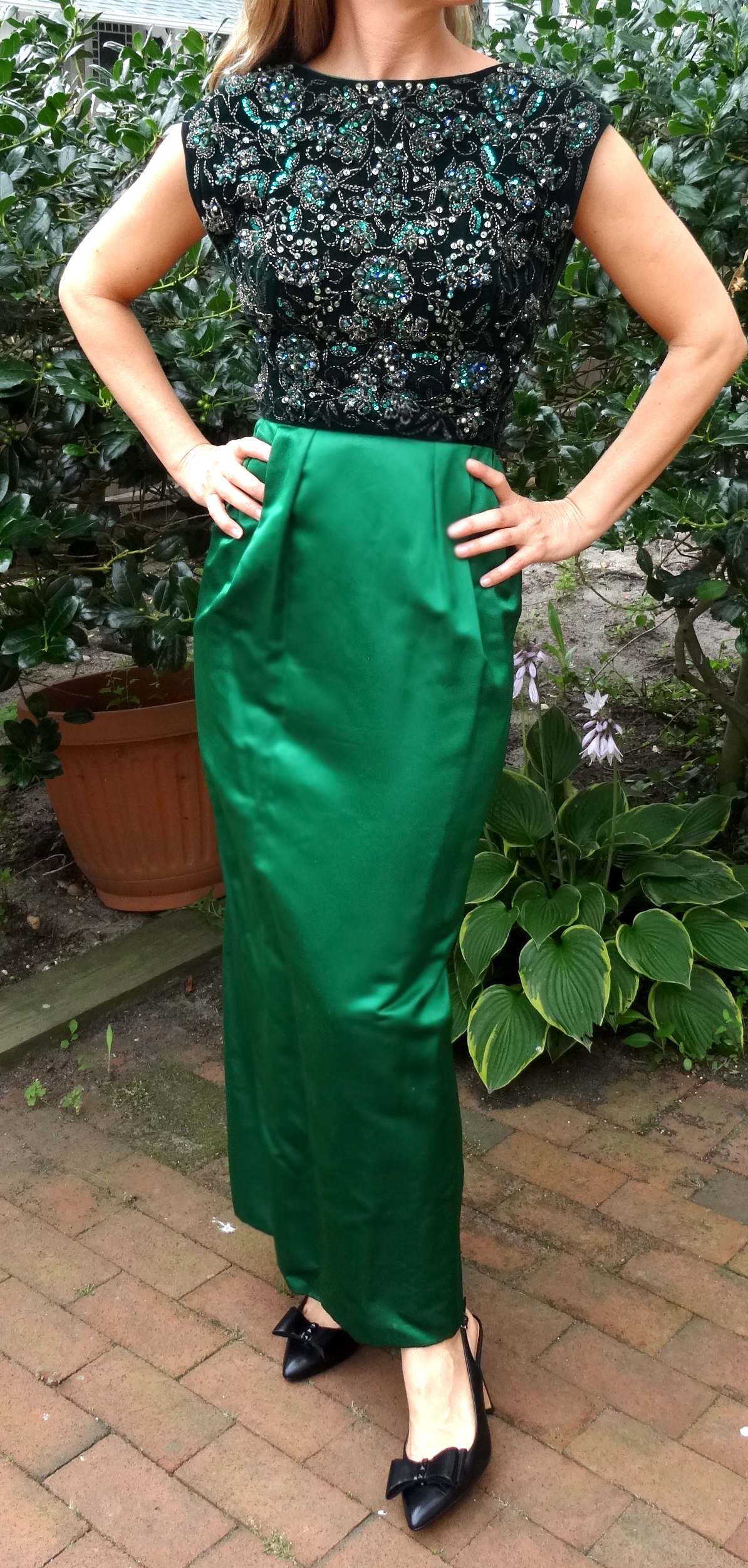 Emerald green silk and velvet embroidered beaded evening gown.