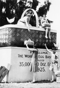 """1918:   Publicist Bert Kerrigan assures the Petaluma Chamber of Commerce that it should continue to put all of its eggs in one basket and stick with the """"little white hen"""" as its economic focus. At his suggestion, the town launches National Egg Day, with a parade and other activities. The festival continues today as the annual Butter & Egg Days in April. (Diane Peterson"""