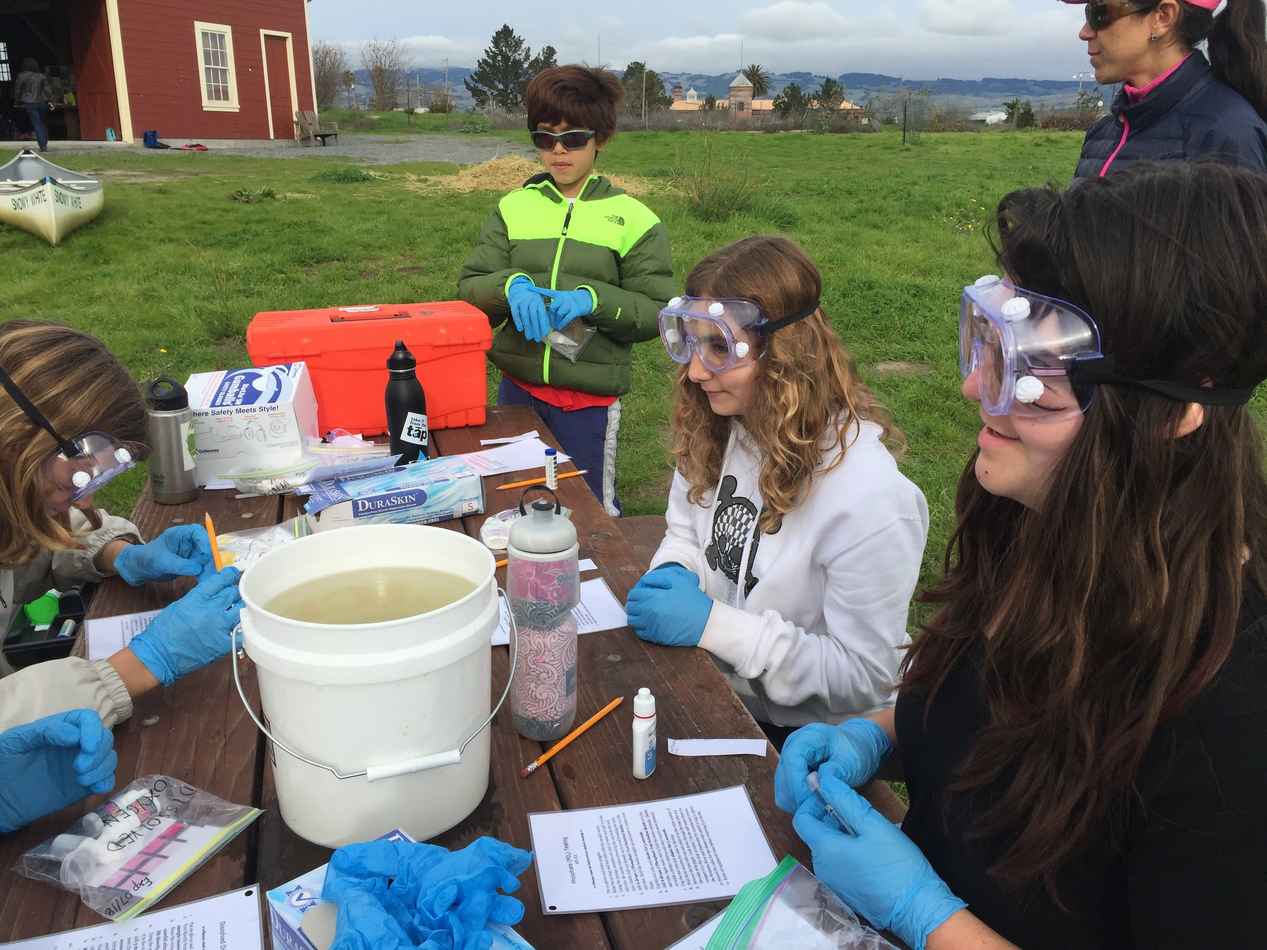 Students water testing at the David Yearsley River Heritage Center.