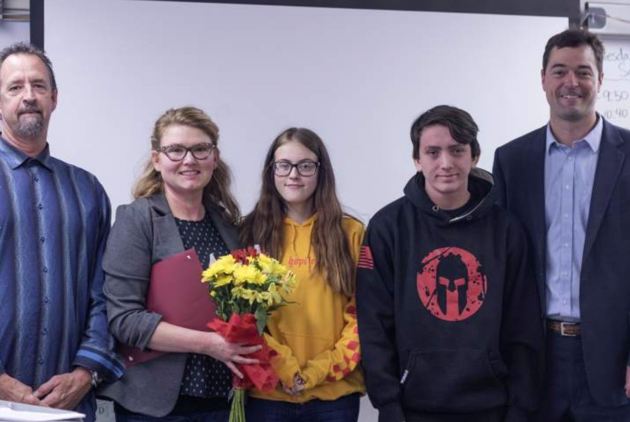 Sonoma Mountain and Carpe Diem high schools principal Gregory Stevenson, science teacher Jessica Dennen, students Lindsey Boyd and Noah Pacheco and a PG&E official at a ceremony honoring the class.