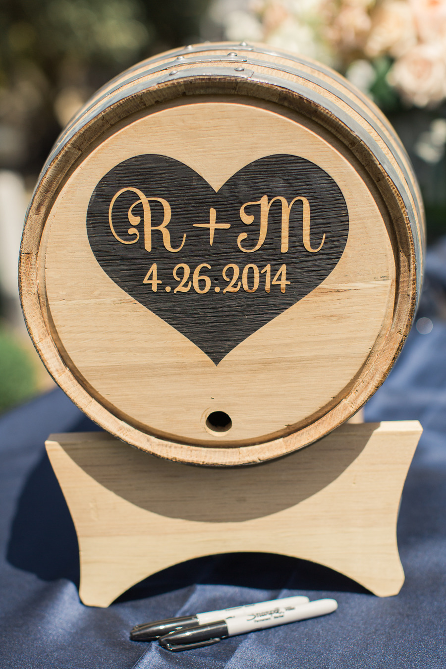 We branded a real oak wine barrel with the couple's monogram for guests to sign.   Photo by Carlie Statsky.
