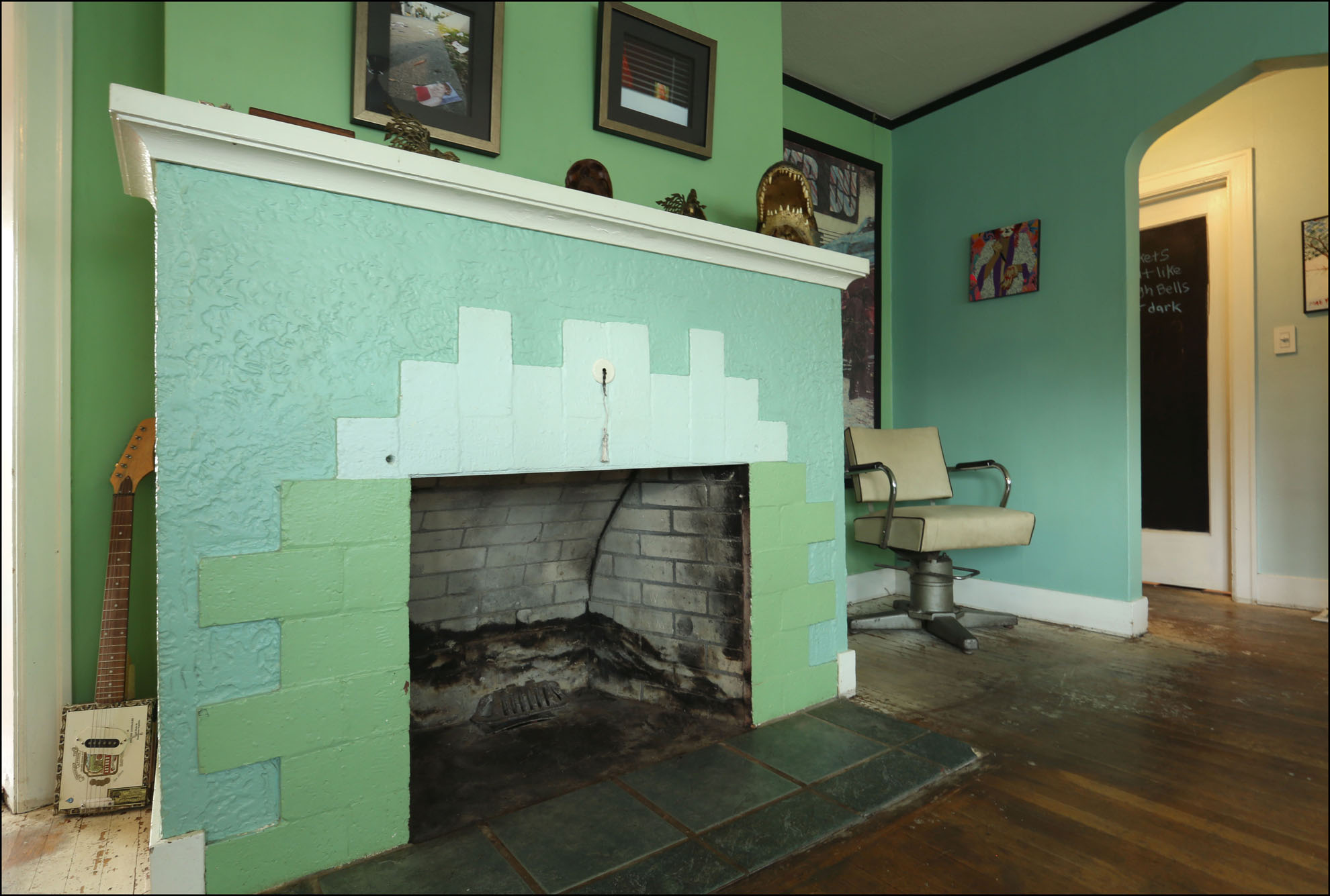 Large fireplace adds character to the living room.
