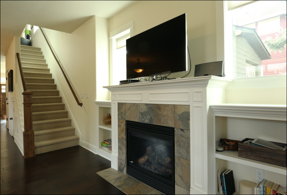 gas fireplace with built-in shelves