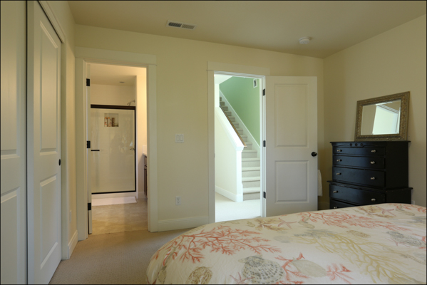 view from master bedroom into bath and hallway