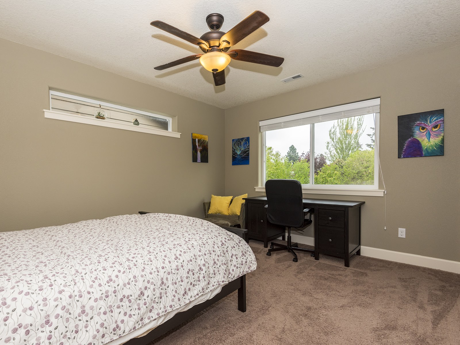 2nd bedroom with large window with a nice view