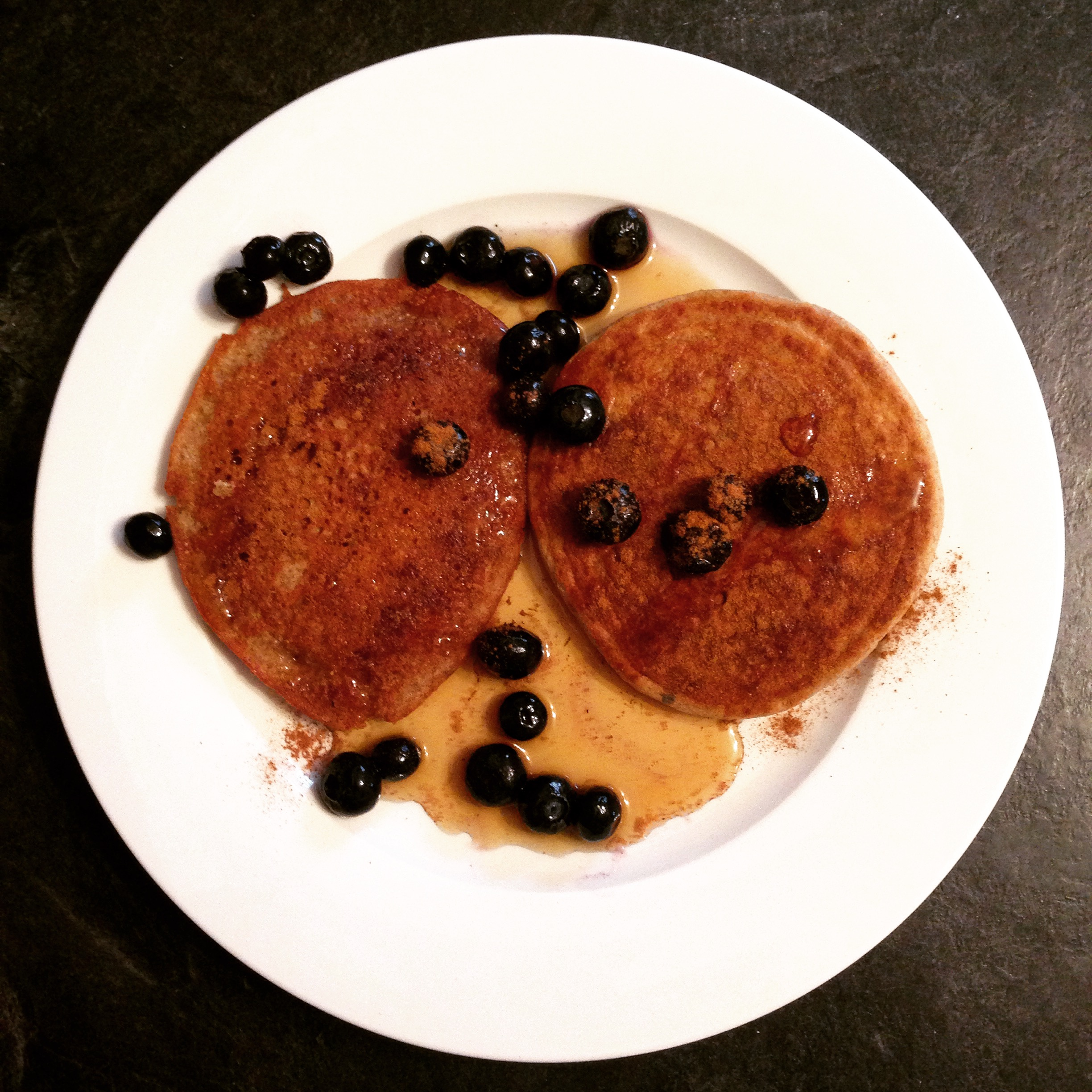 BUCKWheat pancakes with cinnamon, blueberries and pure maple syrup.