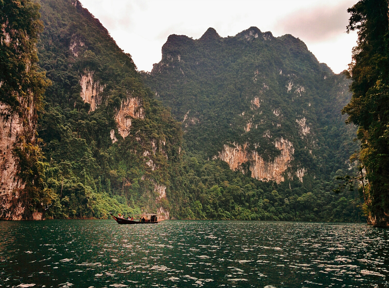 Longtail boat on the man made Cheow Lan Lake, Khao Sok National Park, Thailand.