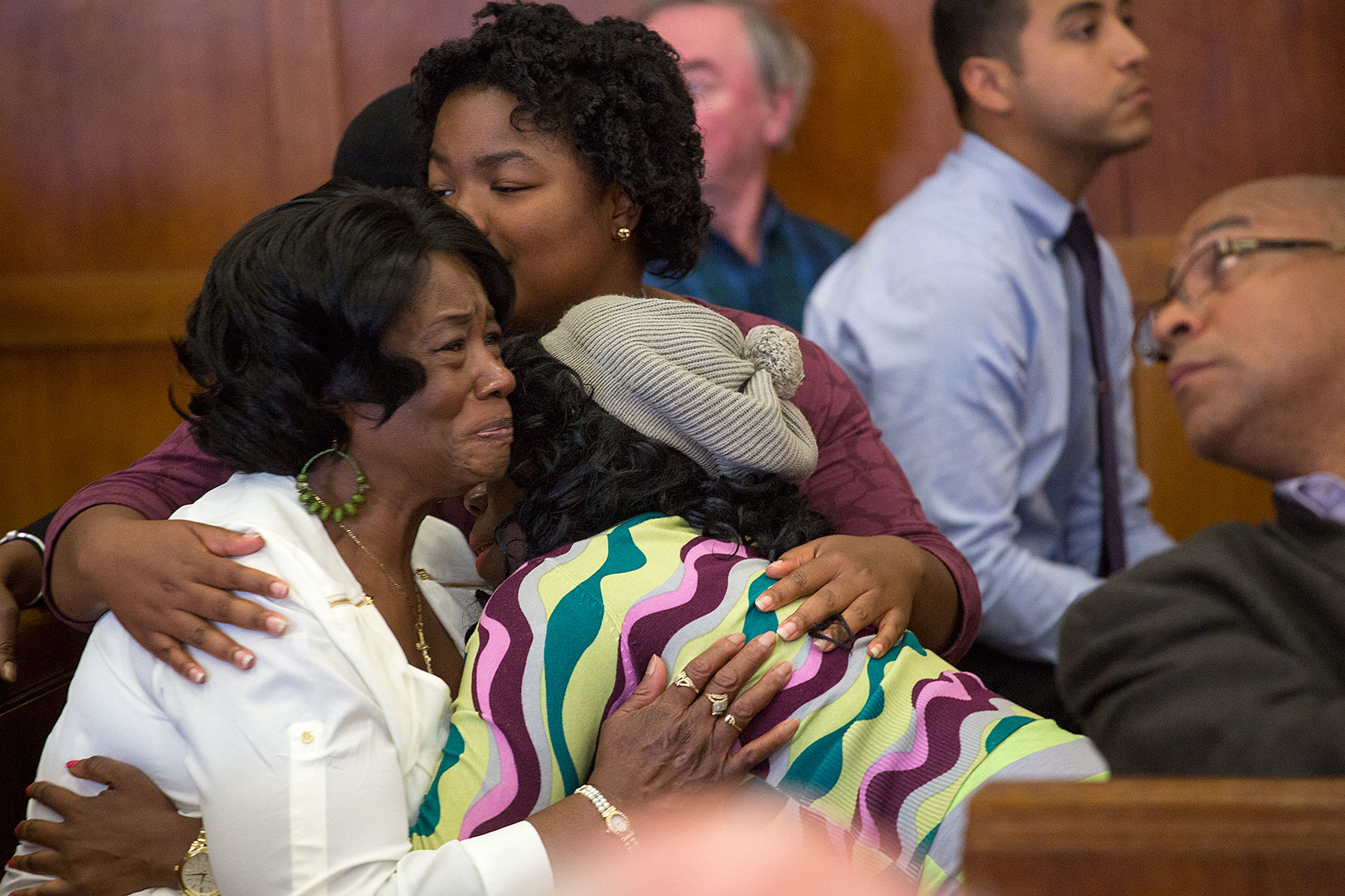 "Sean's mother, Mary ""Jacke"" Ellis, with daughters Sharday (rear) and Janelle. (Jesse Costa/WBUR)"