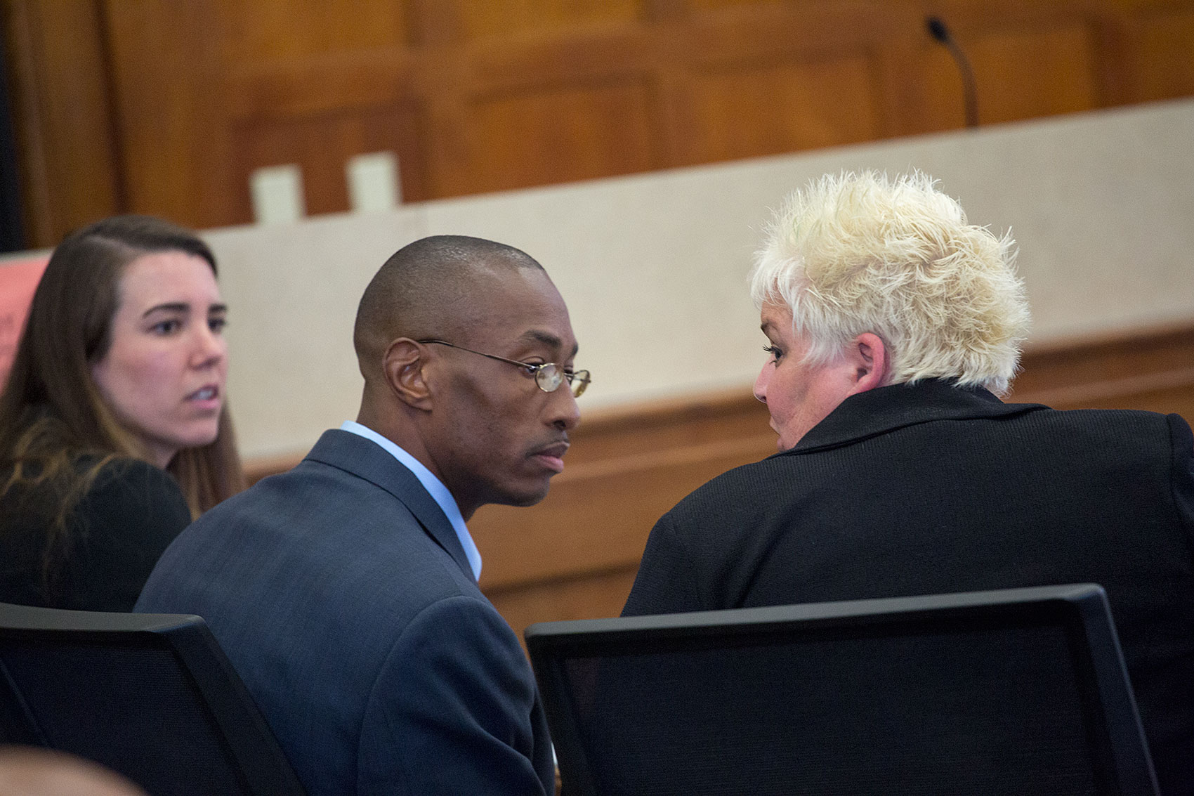 Sean Ellis confers with lead attorney Rosemary Scapicchio; attorney Jillise McDonough at left .