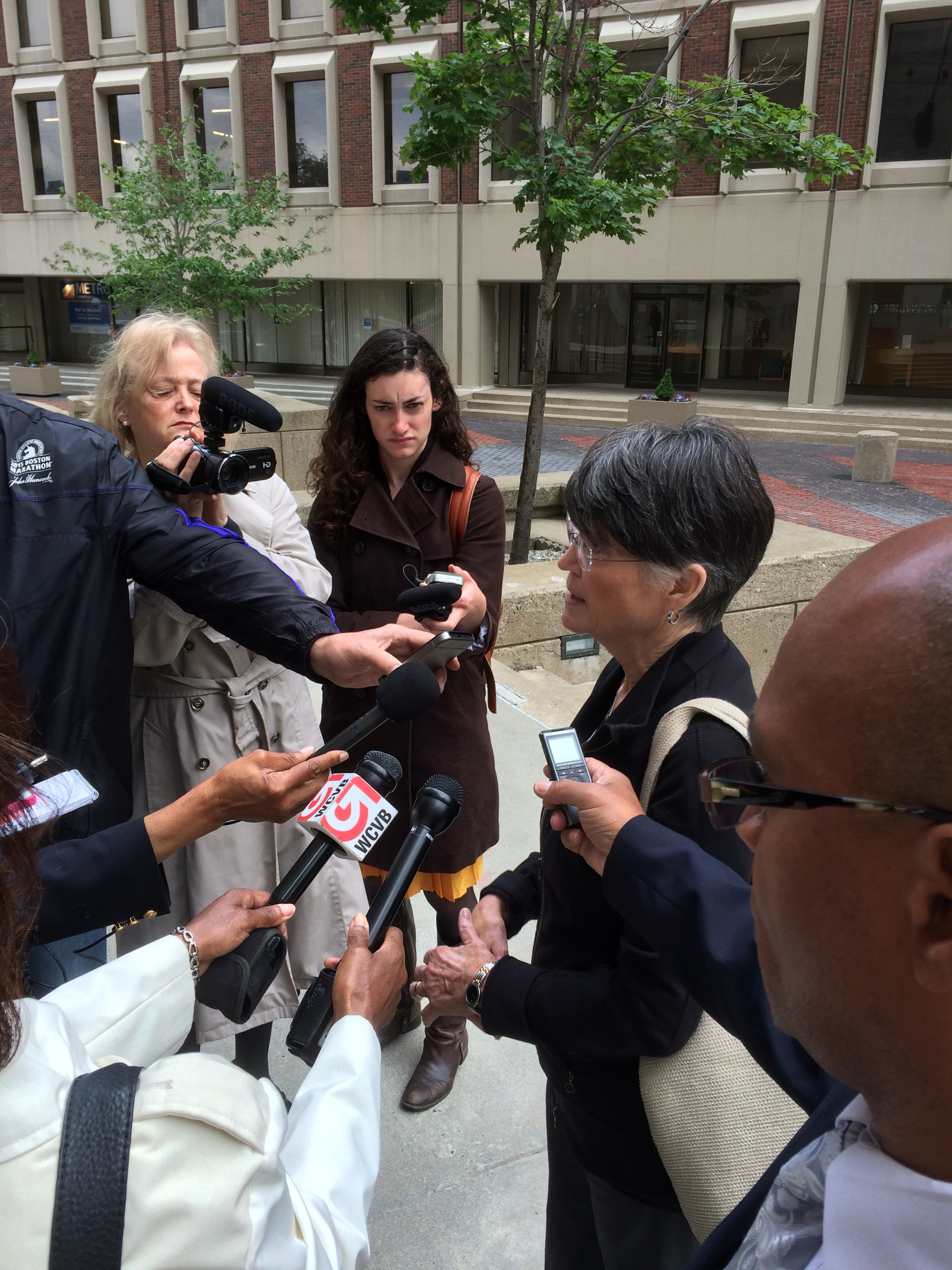 Elaine Murphy speaking to the press outside Boston's Suffolk County Courthouse after Sean Ellis's release on bail on June 3, 2015.