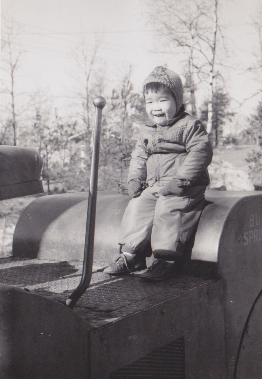 A photo of Janine from her childhood in Lexington, MA back during her pre-design days when she saw a future in heavy construction machinery.