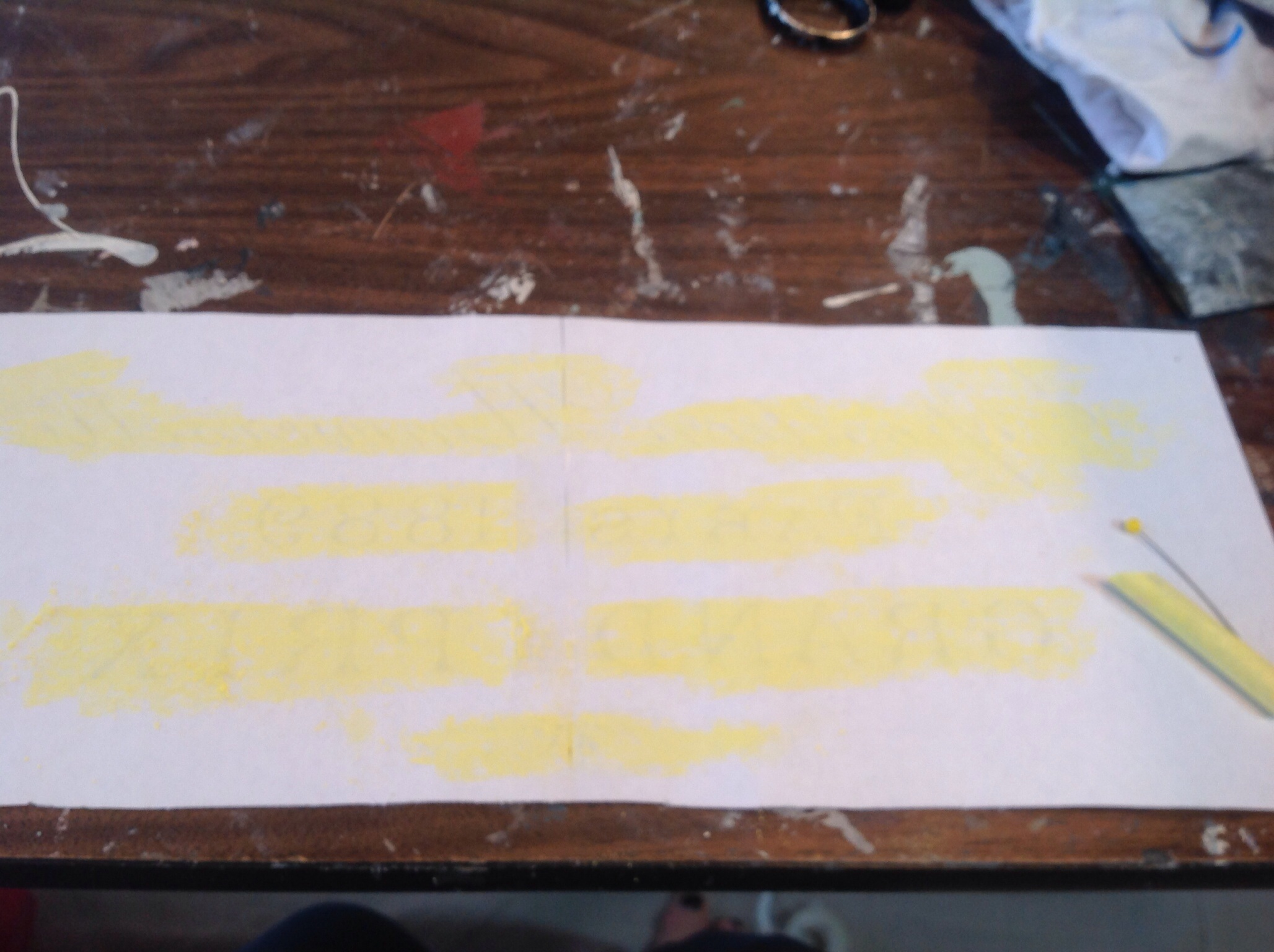 Rub chalk all over underside of graphic to allow tracing of the image onto table top