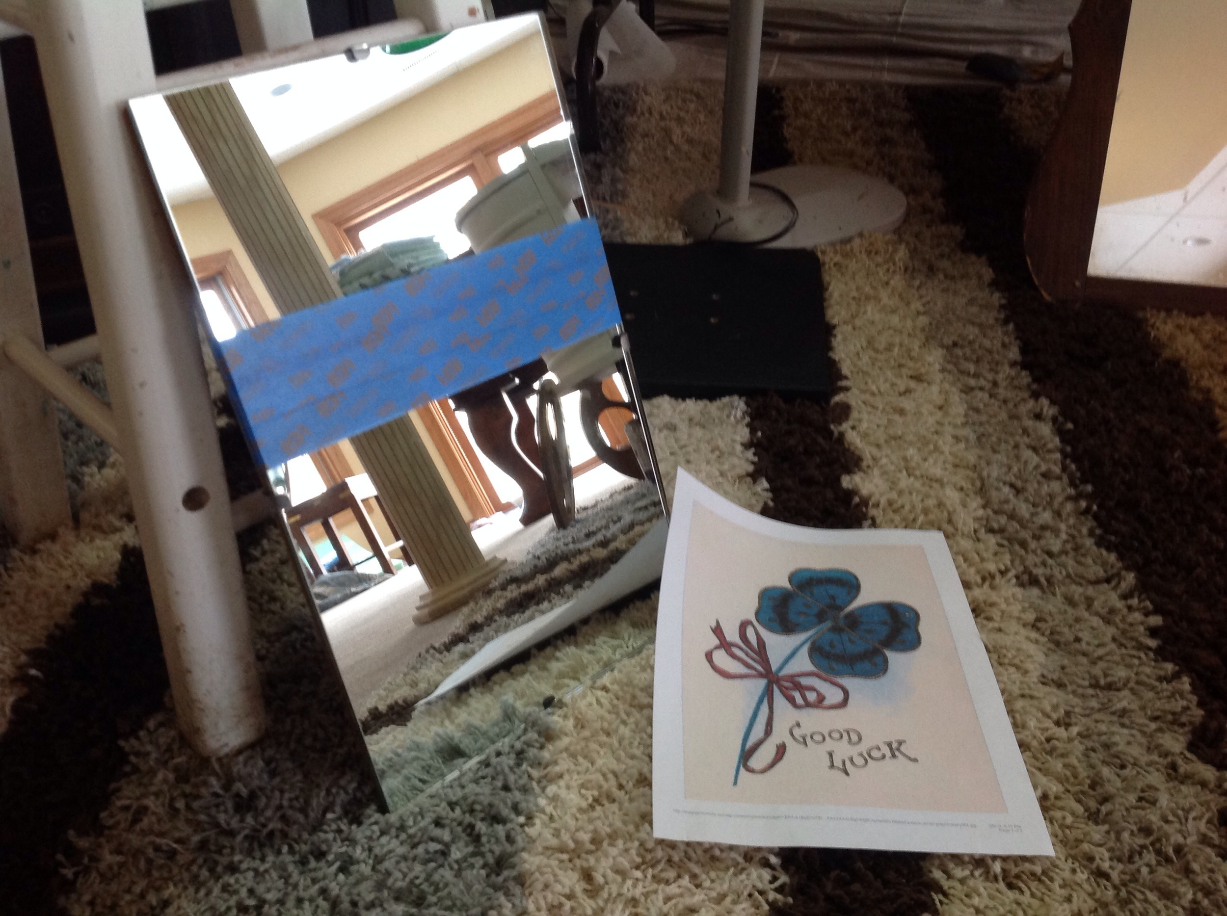 Using blue painters tape, tape the entire surface pressing down firmly as you go. You're going to cover most of the mirror.