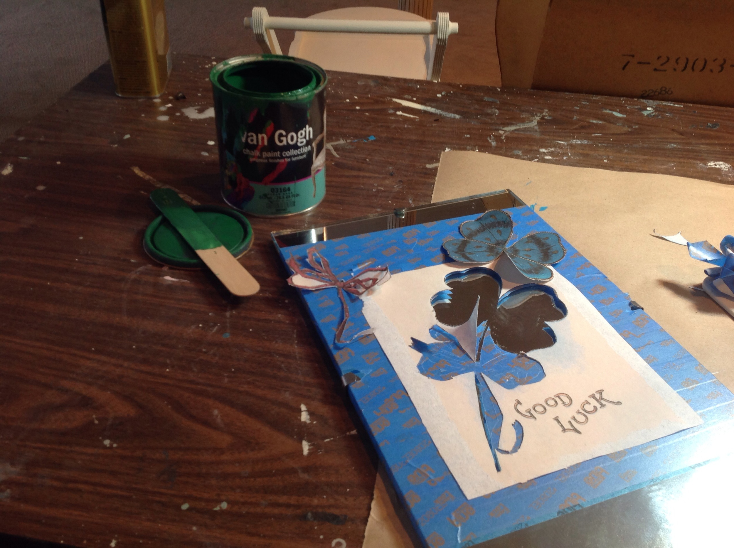 I cut out the red bow but did not remove the blue tape until after the shamrock was painted and dry.