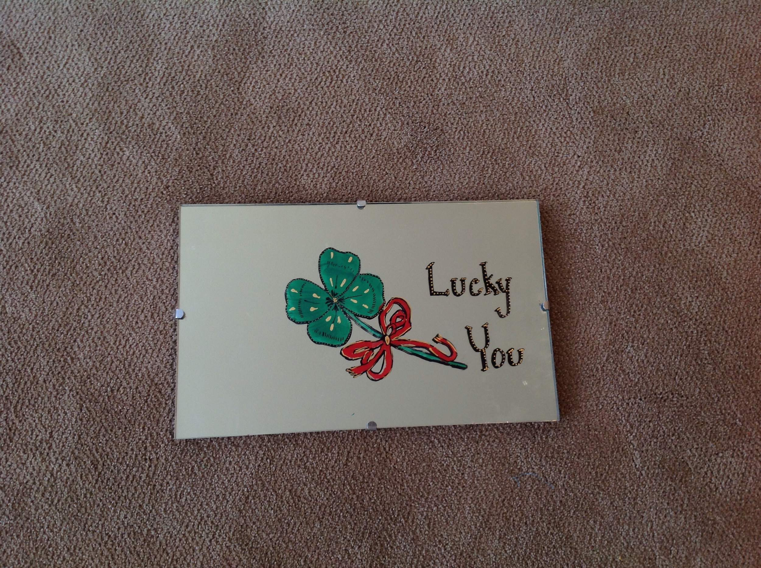 """It turned out really cute. I tried to photograph it without showing the reflection. I added """"Lucky You"""" because I thought that would be a more year-round saying. I just free handed these letters. I didn't want to get too fussy with cutting around letters."""