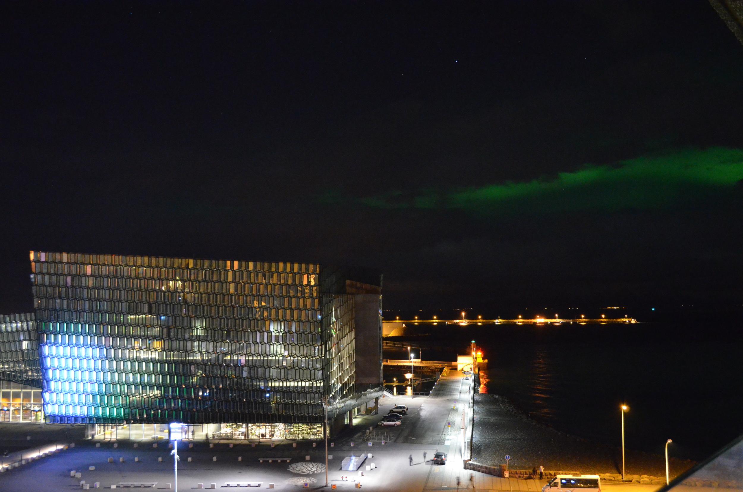 The Northern Lights dance past the Harpa Concert Hall in Reykjavík