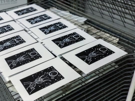 "Process shot of the artist's linocut ""Mantis Moon"" prints."