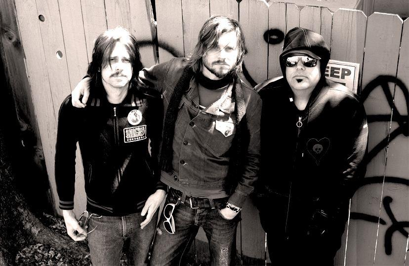 Wirepony (2008) Eddie Glass, Patrick & Otis B in Austin, TX outside the TV studio where we taped a live performance for SXSW. This was the rowdy punk rock version of Wirepony. I loved playing with Eddie Glass. I wish we'd recorded with this lineup. We never did though. Photo  Jeff Wiant