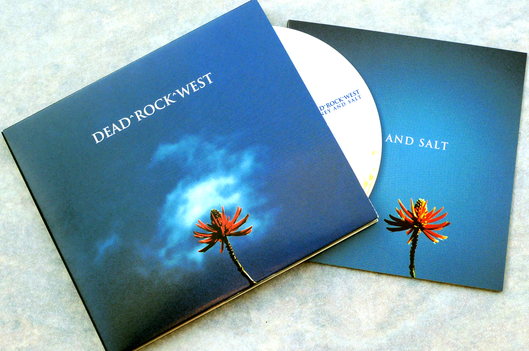 Dead Rock West CD (2006). Art Direction & Packaging Design. Photographer Frank Lee Drennen. This package featured a full color photo book of Frank's photo work, who is also in the band. We had a stack of film shots and negative scans to choose from that he had taken on tour and at home which made it both exciting and challenging at the same time. With such a rich and varied color and subject pallet to work with, we kept refining the choice of images that would compliment the lyric scattered throughout the book and best capture the wide cinema-scope nature of the music. I'm still amazed at how I ever finished this package on the ancient and failing Mac computer which I was working with at the time. It could barely process the extensive layout files with the doubly high-resolution scans of these film-camera shots that I insisted on. Somehow we did it and it came out fantastically.