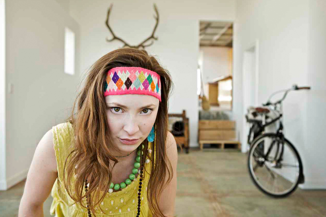 Electra Bicycles (2009). Creative & Photo Direction for 2009 International campaign. Photographer Art Brewer. The concept we created was that your Electra Bike becomes such an important part of your life, that it knows your secrets. Like this shot of Michelle, custom clothing designer, being watched while vamping by her Electra, companion and play pal.