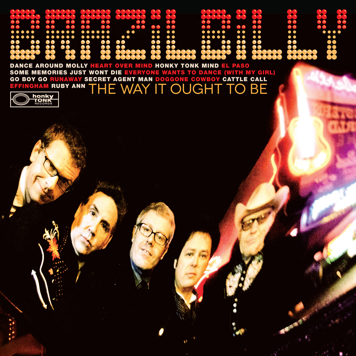 Brazilbilly Vinyl LP (2012). Art Direction & Packaging Design. We shot this picture outside the legendary Robert's Western World in Nashville between rain bursts on a quiet Monday night on the strip. This shot is actually a reflection of the band not a direct shot. Notice the Robert's sign which reads backwards. We used singer Jesse Lee's 1955 Cadillac's trunk lid, parked it outside of Robert's and placed the photographer Stacie Huckeba in a few precarious positions in order to capture the band in a modern twist on the classic old Nashville album covers of the 60s and 70s.