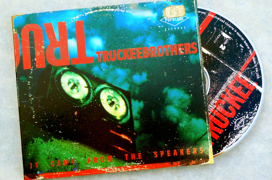 Truckee Brothers CD (2005). Art Direction & Packaging Design. Front cover. I used the type and wear from three of my favorite albums growing up for this. The wear from my father's copy of Moody Blues 'Threshold Of A Dream' which he bought in Spain where I was born, the typeface and treatment from my copy of Springsteen's 'Nebraska' which I bought when I was 16 and forming my first band and the sales sticker from my copy of the Stones 'Let It Bleed' which i bought for 3 quid at a car boot sale when I was living outside Manchester, UK in the early 90s. Add in Frank's spooky shot of a looming reel to reel tape machine and we had the makings of a 1950s horror film poster, which is what we were going for after all. 'It Came From The Speakers'. Photographer Frank Lee Drennen.