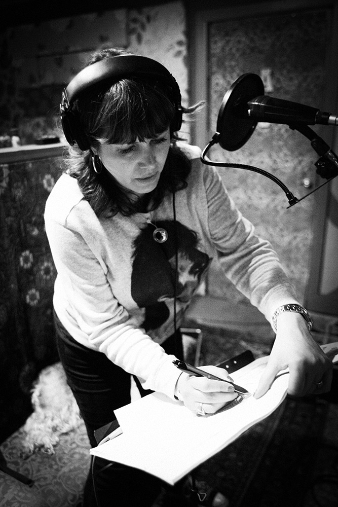 Cindy Wasserman  singing 'Love Is A Bomb'  during the 'Fürst In The Dirt' sessions, notating the usual last minute lyric changes.(2014). Photo Stacie Huckeba.