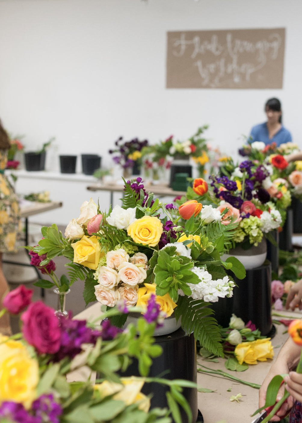 Maxit Flower Design's floral workshop in full swing. Maria teaching the attendees how to prep flowers.
