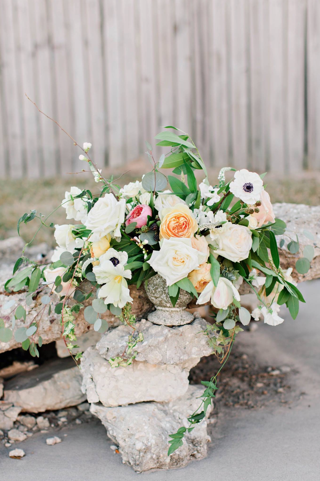 Compote floral arrangement with cement base by Maxit Flower Design in Houston, TX.