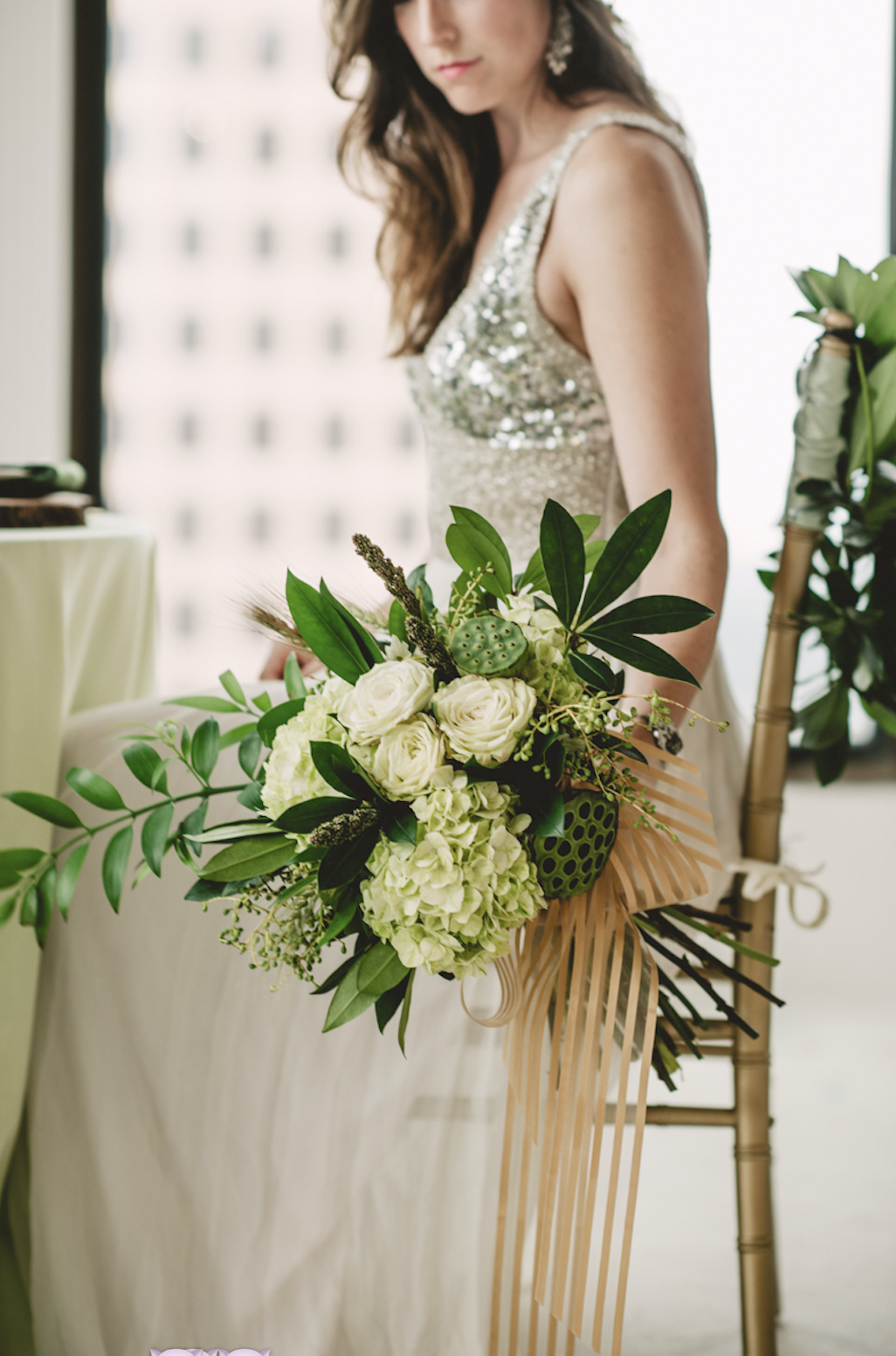 A stunning all white bridal bouquet with touches of greenery and fun textures.