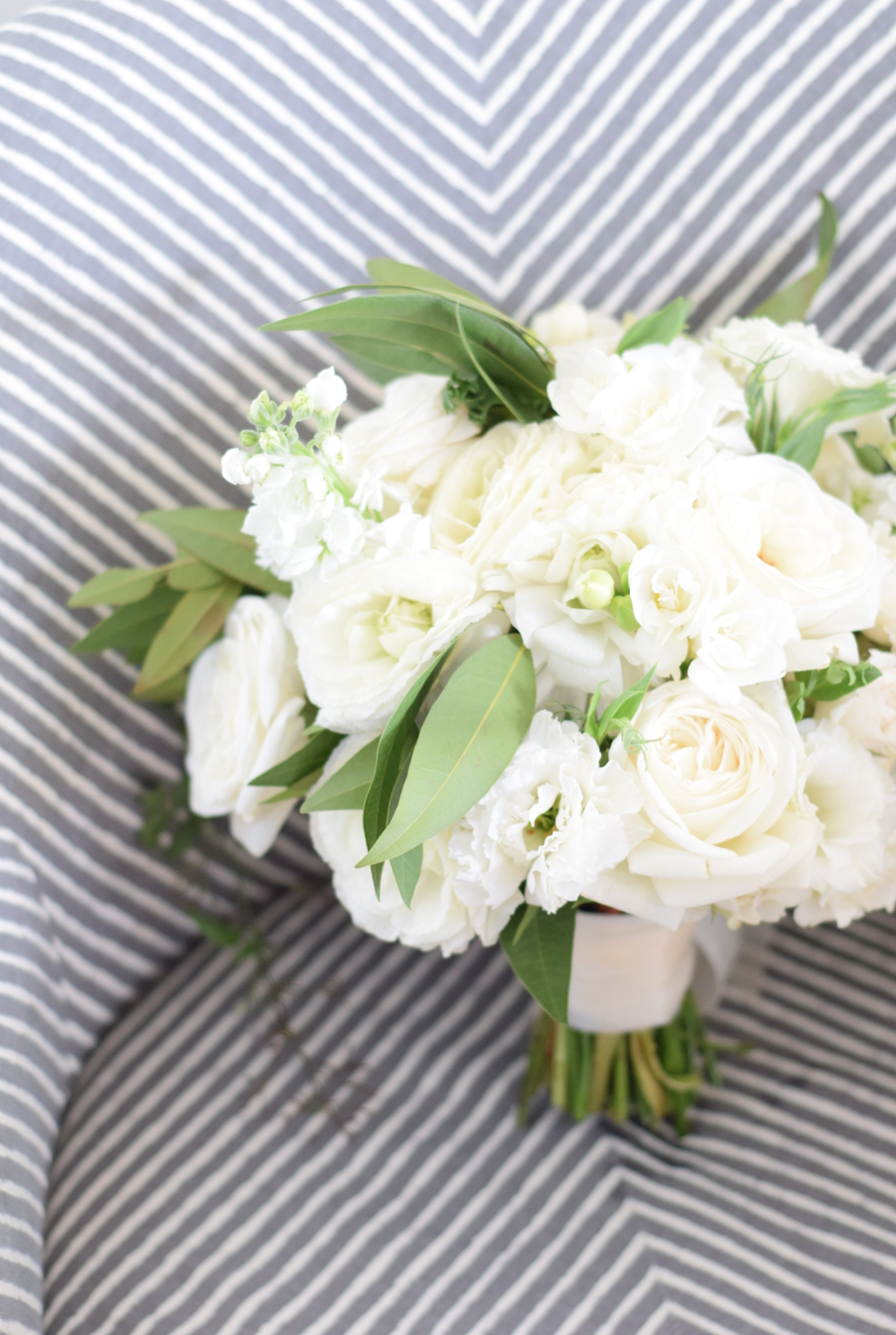 An all white bouquet really stuns when paired with a bridal gown.