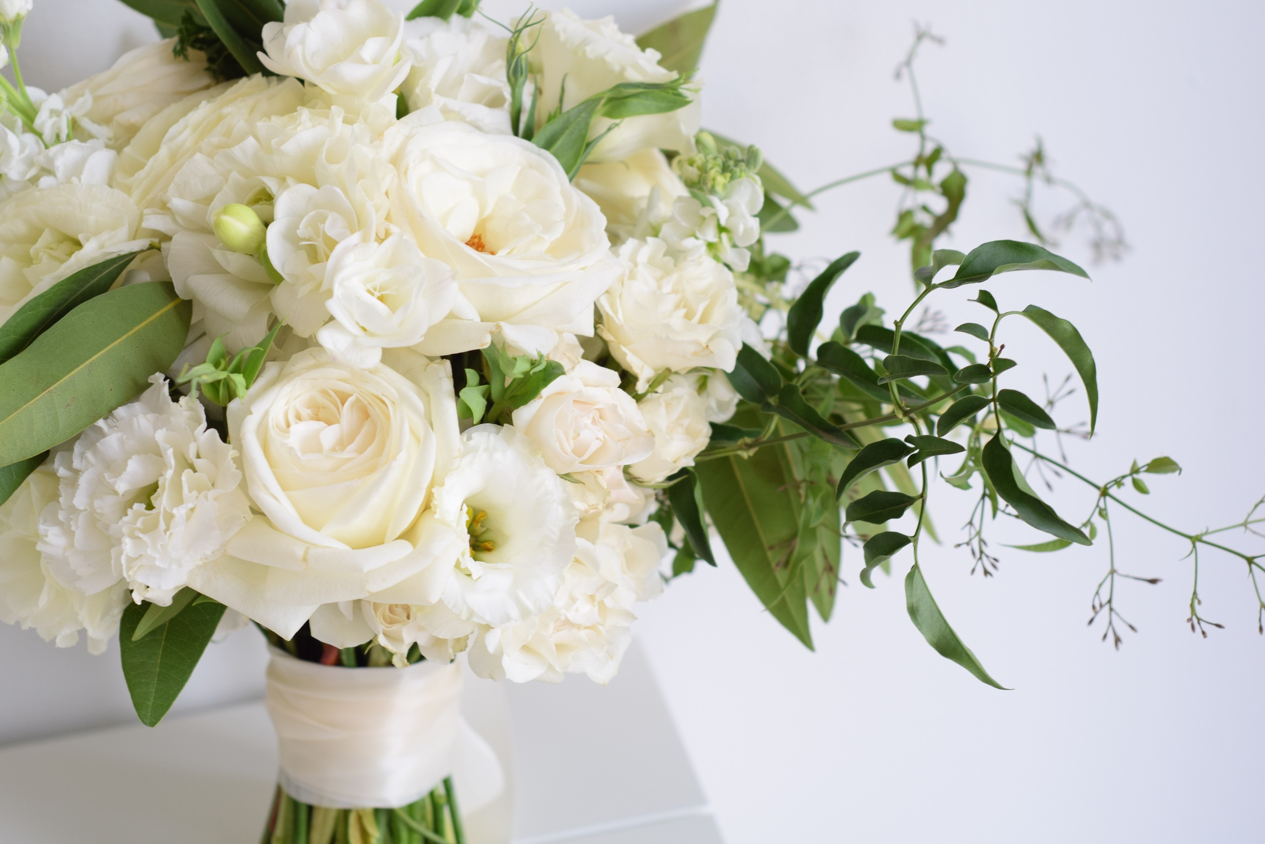 A simply white bridal bouquet is perfectly understated.