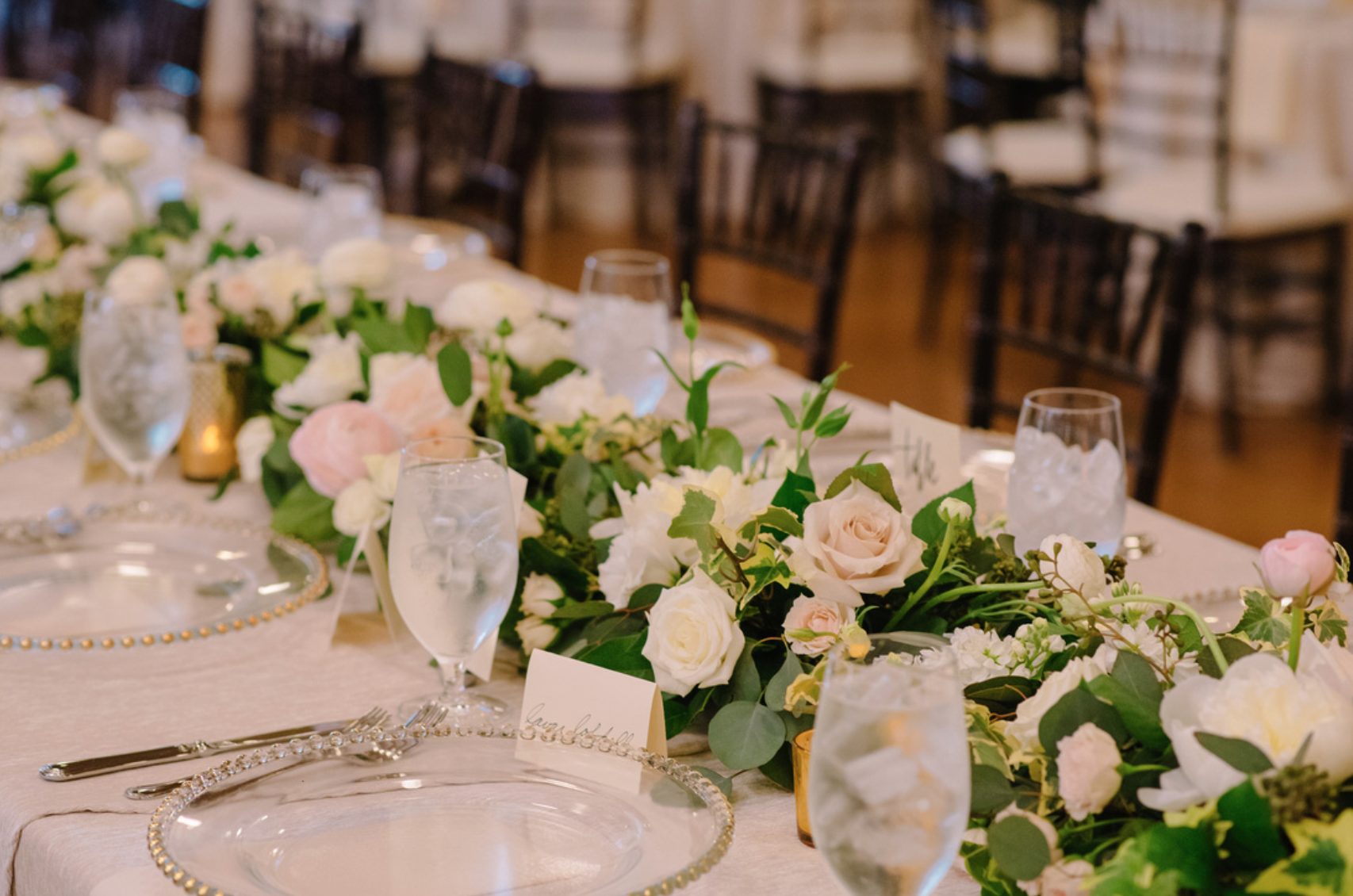 Lucious floral garland on the rectangular tables.