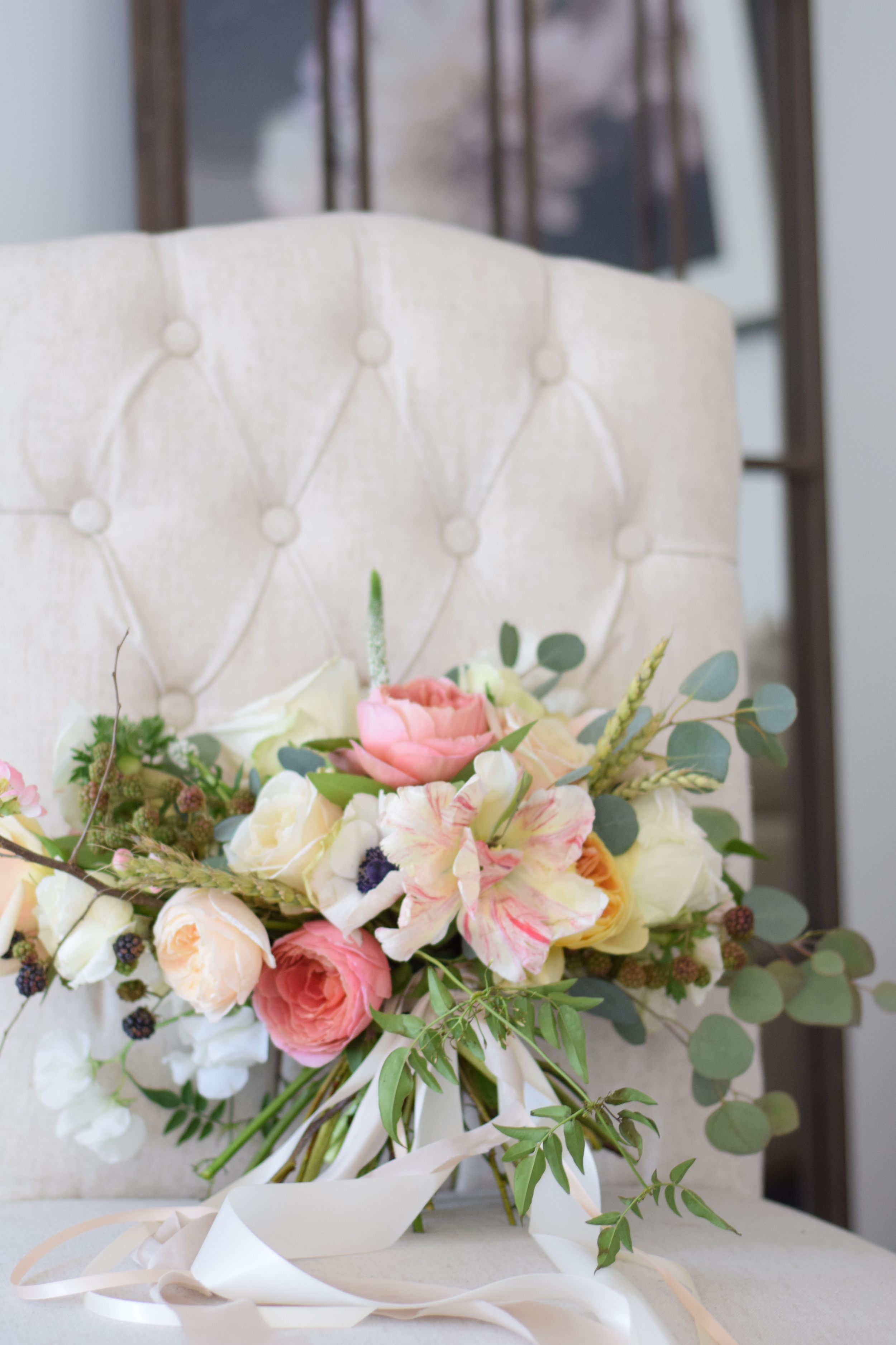 Blush, white and green are the star colors in this bridal bouquet.