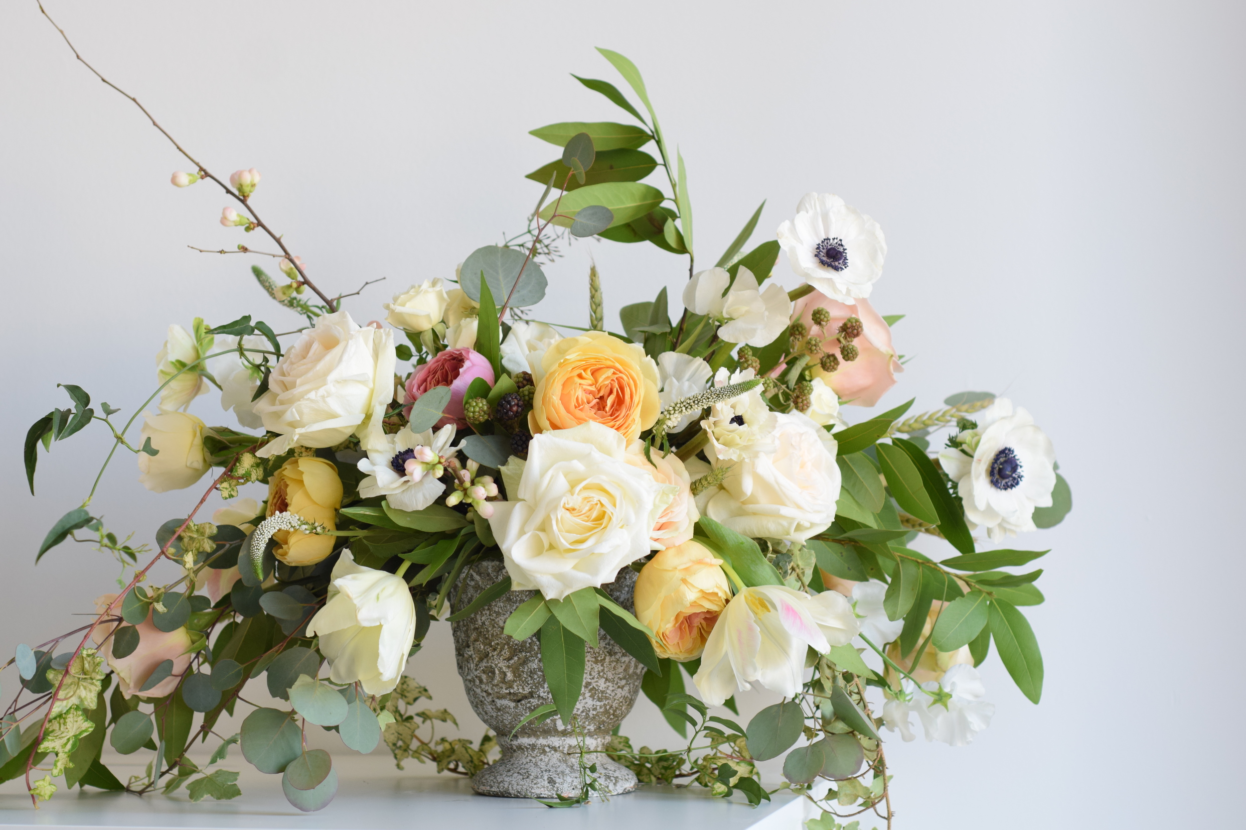 Organic loose arrangement featuring anemones by Maxit Flower Design.
