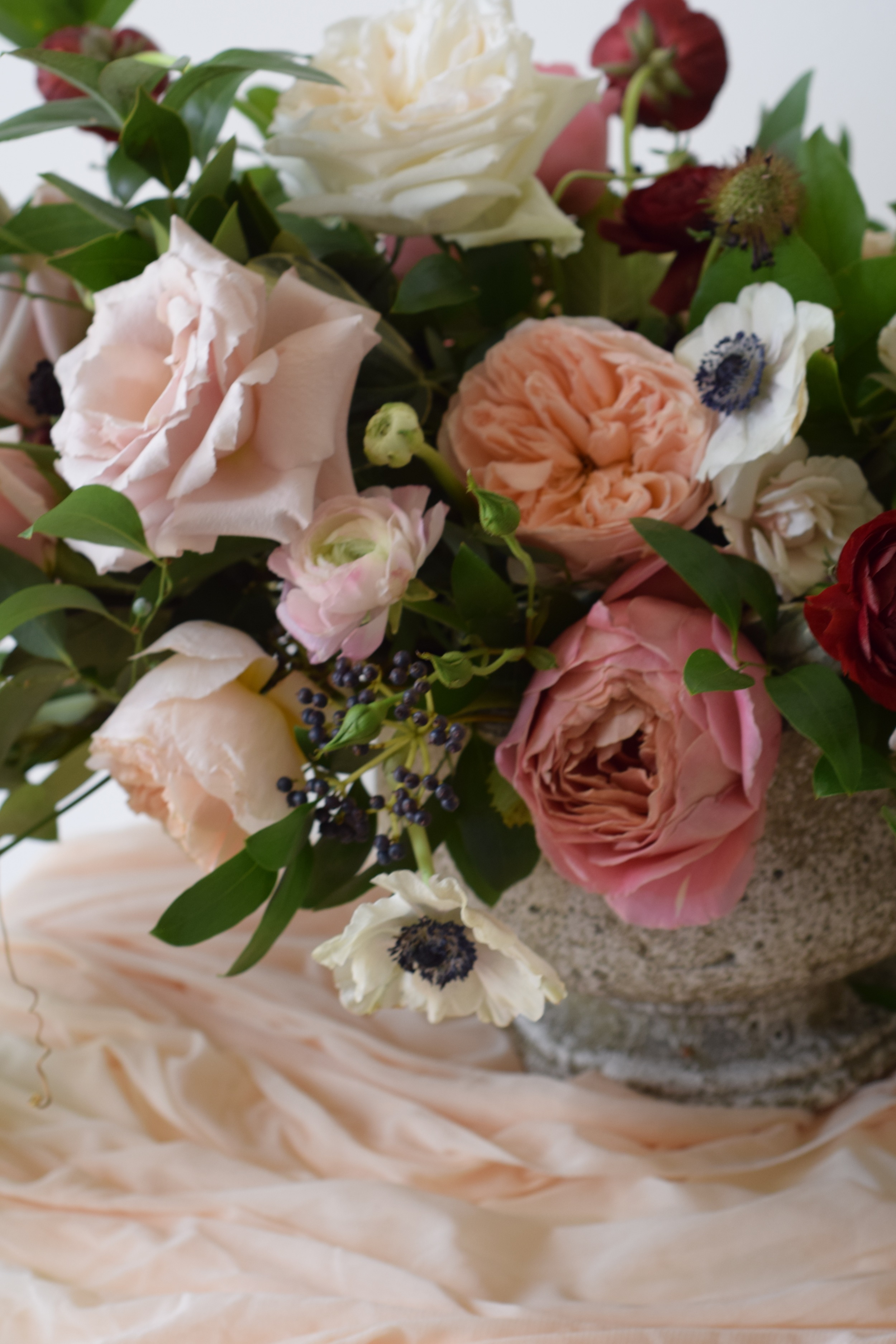 creatives being copied flower arrangement anemones greenery