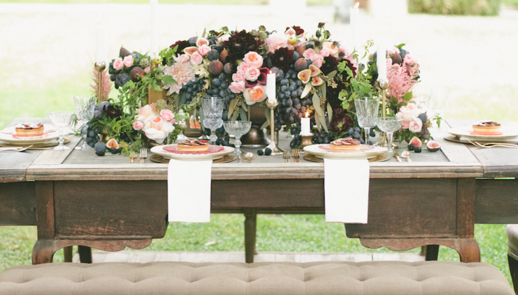 Stunning tables cape by Seed Floral including figs, grapes and pink florals.