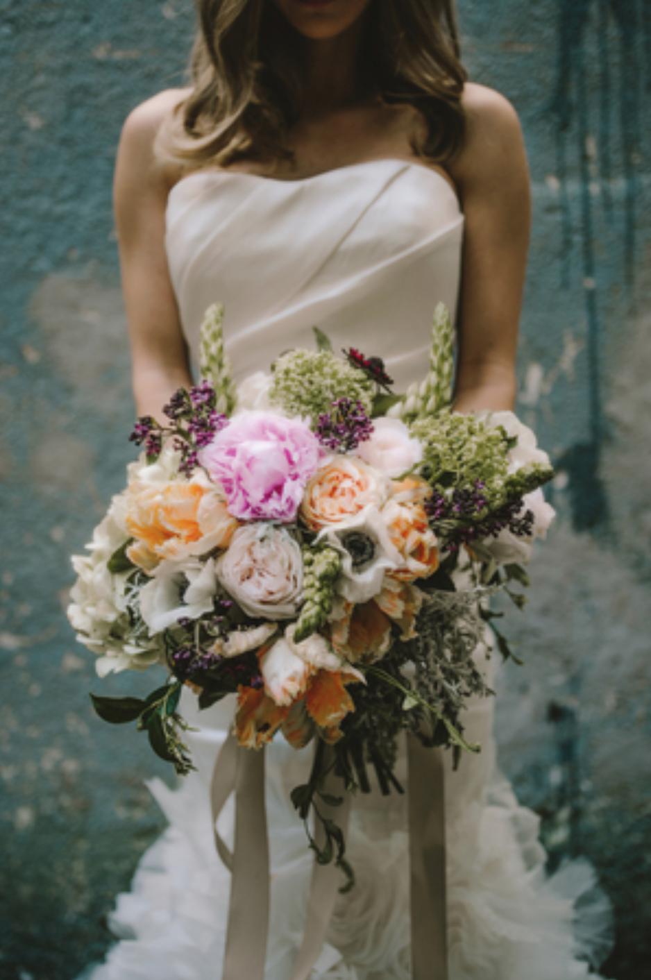 Big blushing flower bouquet with orange, pink & anemones. By Maxit Flower Design in Houston, TX.