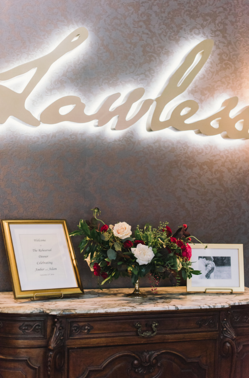Welcome area at Lawless in Houston, TX. Whimsy floral arrangement by Maxit Flower Design.