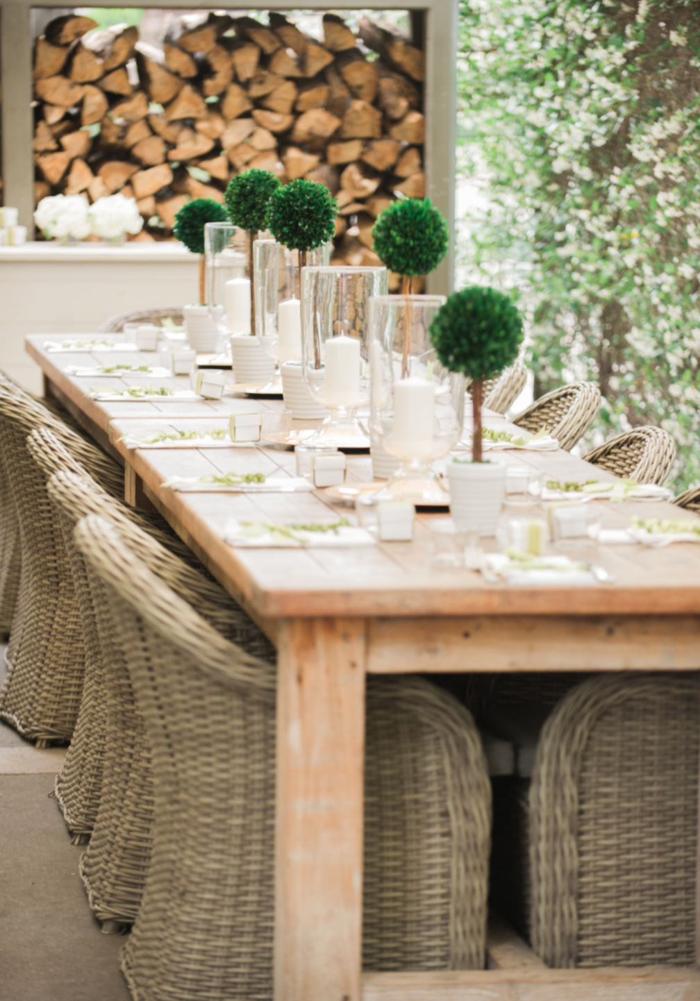 Tablescape with candles on the outdoor pavilion.