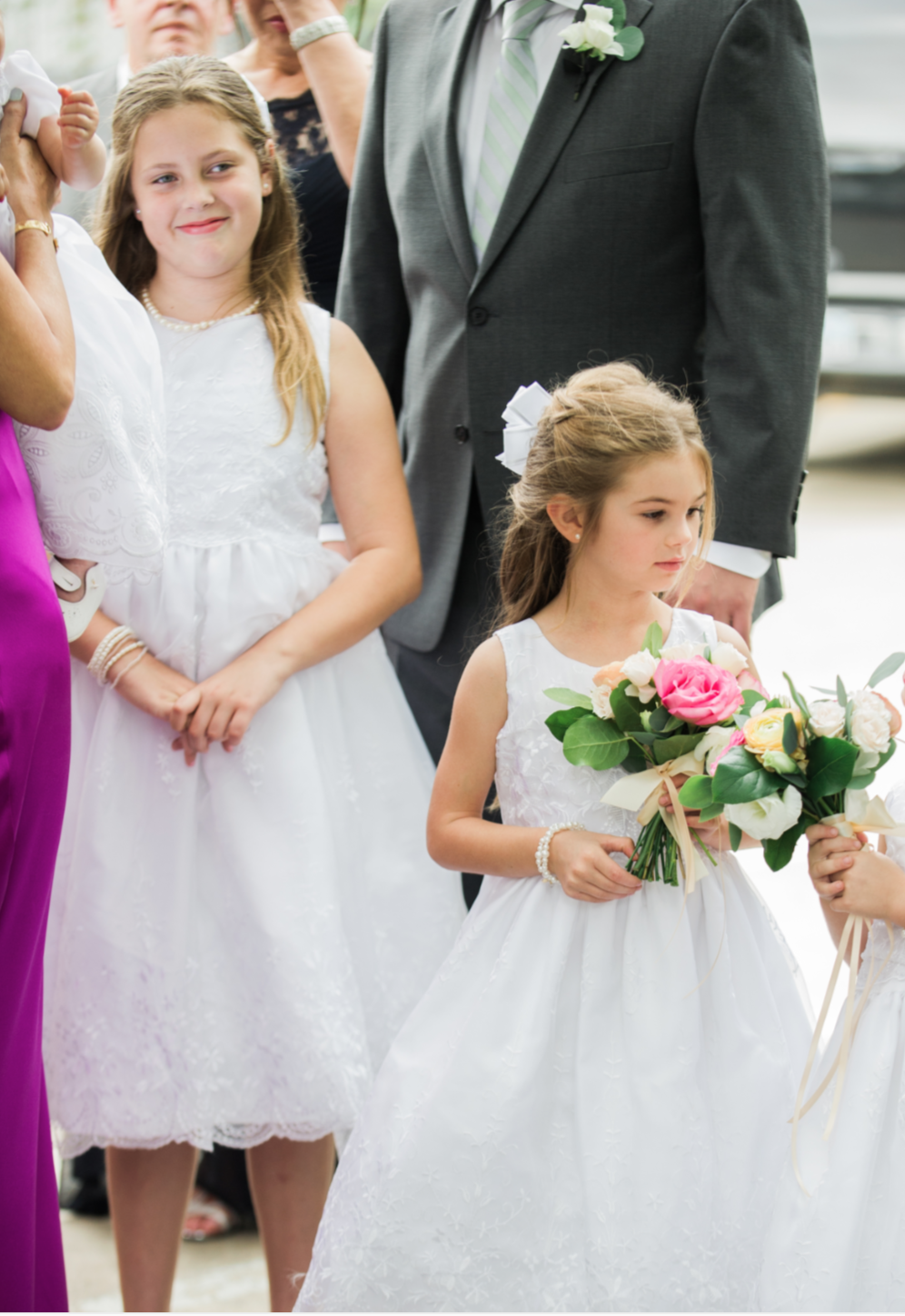Flower girl getting ready to walk down the aisle.