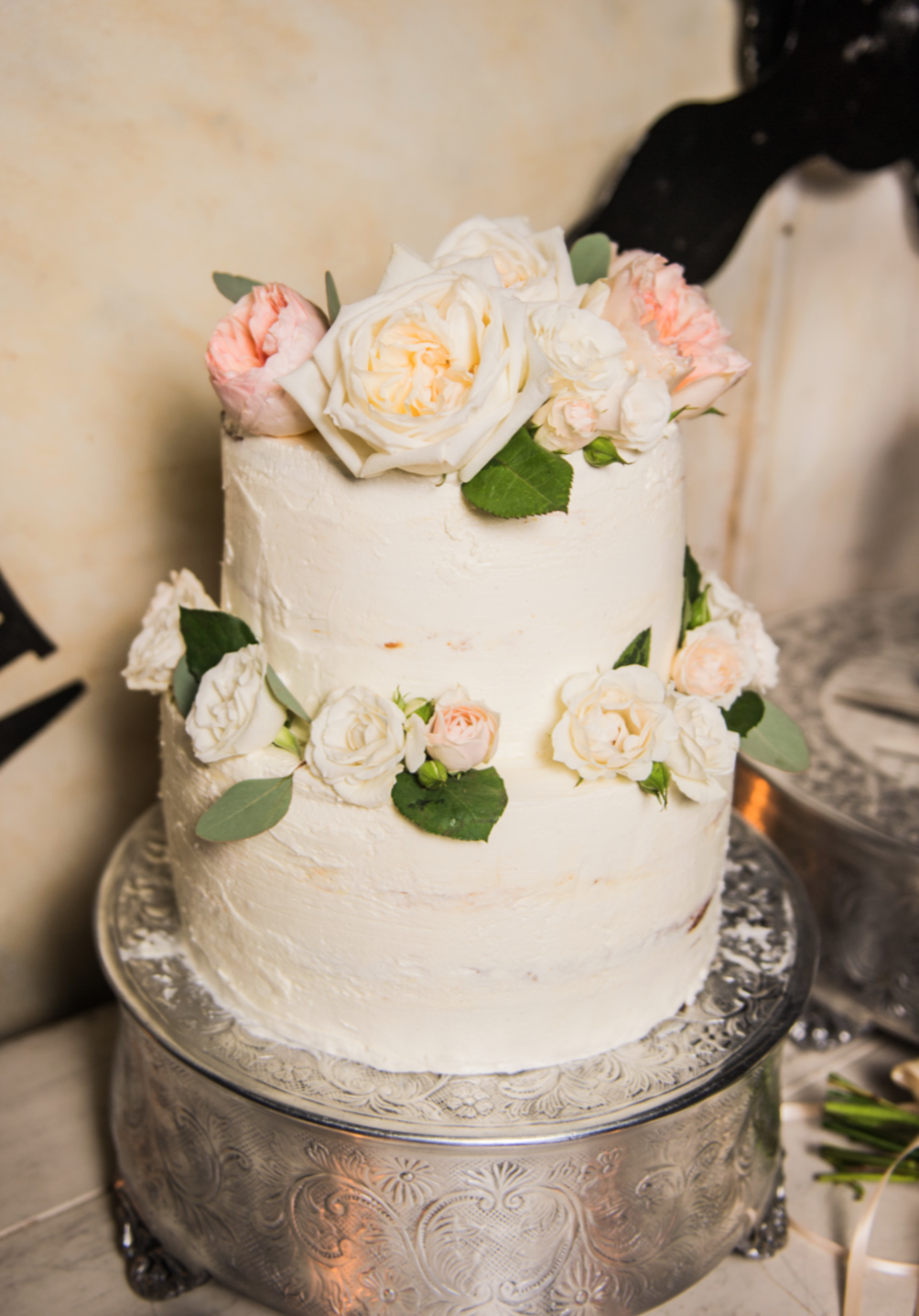 An almost naked cake with florals provided by Maxit.