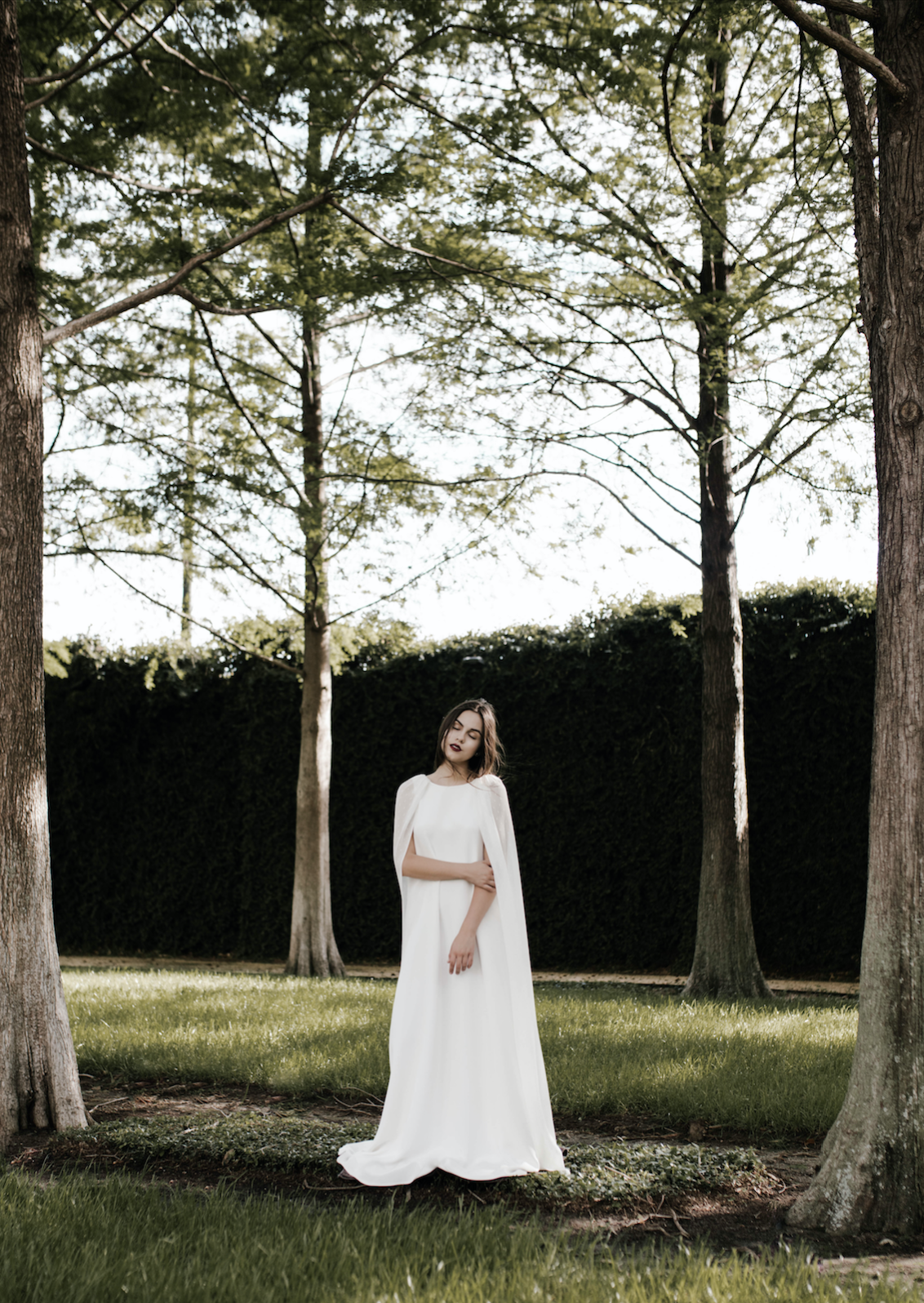 flowy white gown with large organic greenery bouquet by maxit flower design in houston, tx