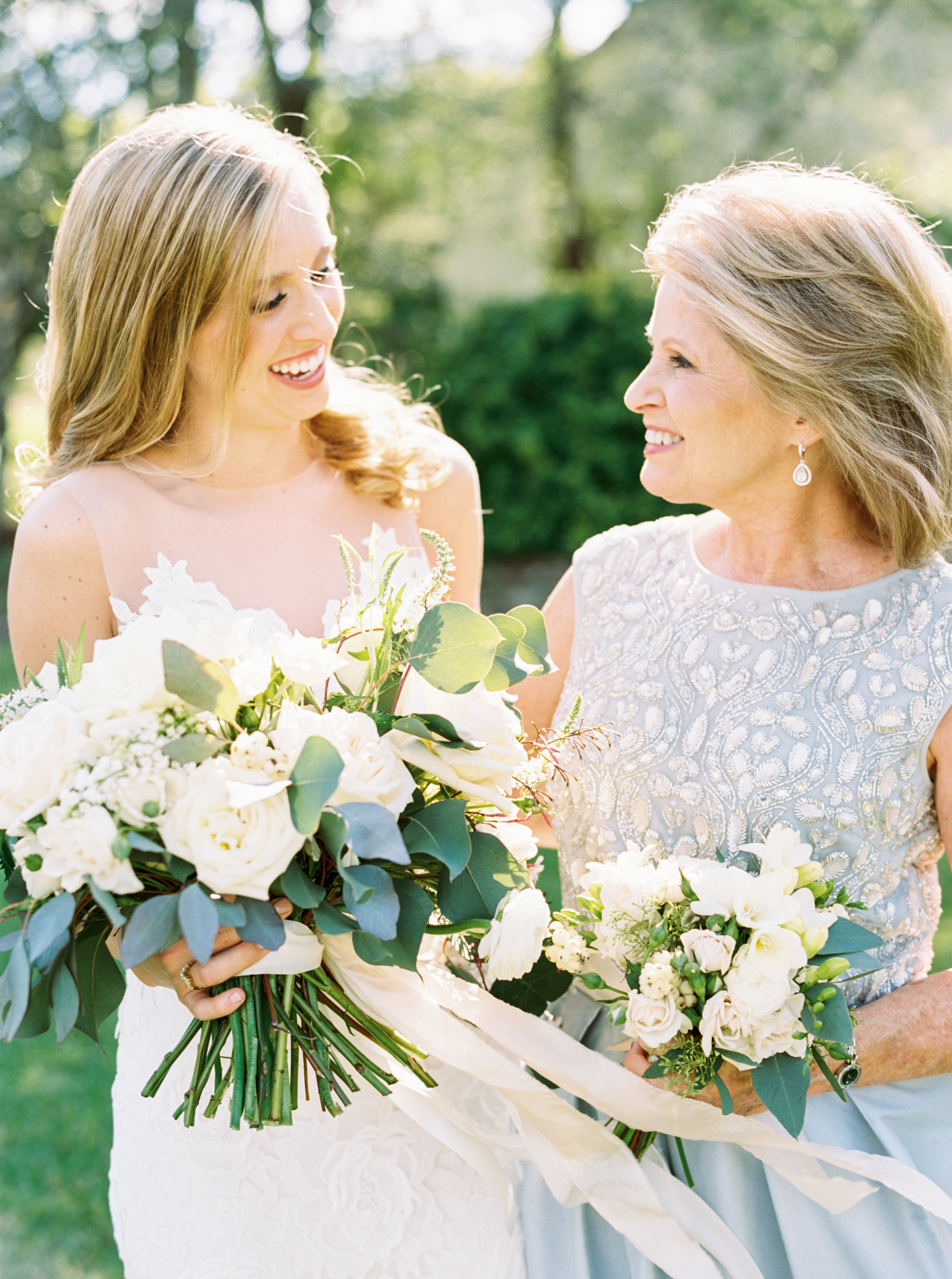 mother and bride with flowers from maxit flower design in houston texas