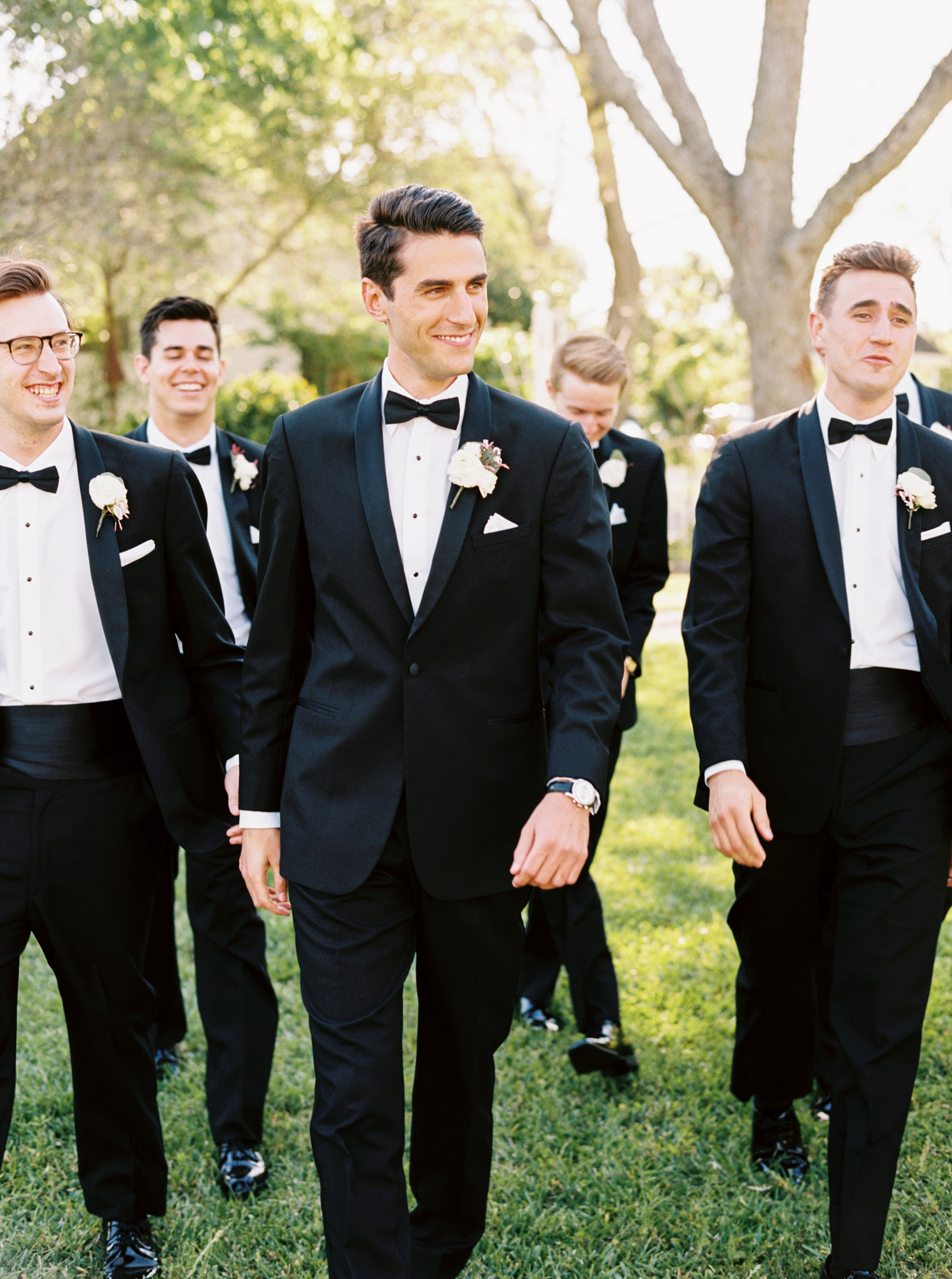 groomsmen in black tuxes with boutonniere by maxit flower design in houston texas
