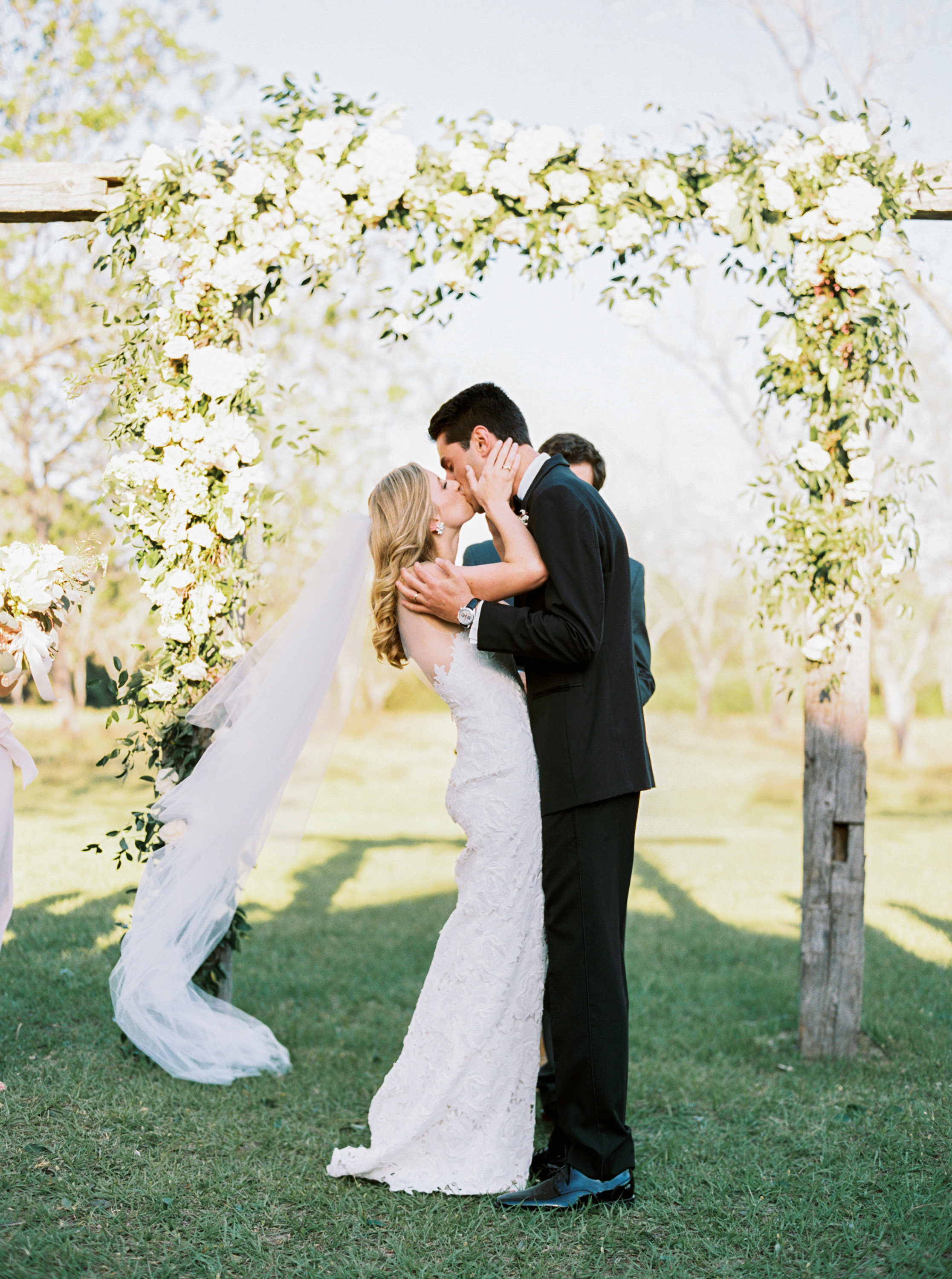 kissing after the ceremony flowers by maxit flower design in houston texas