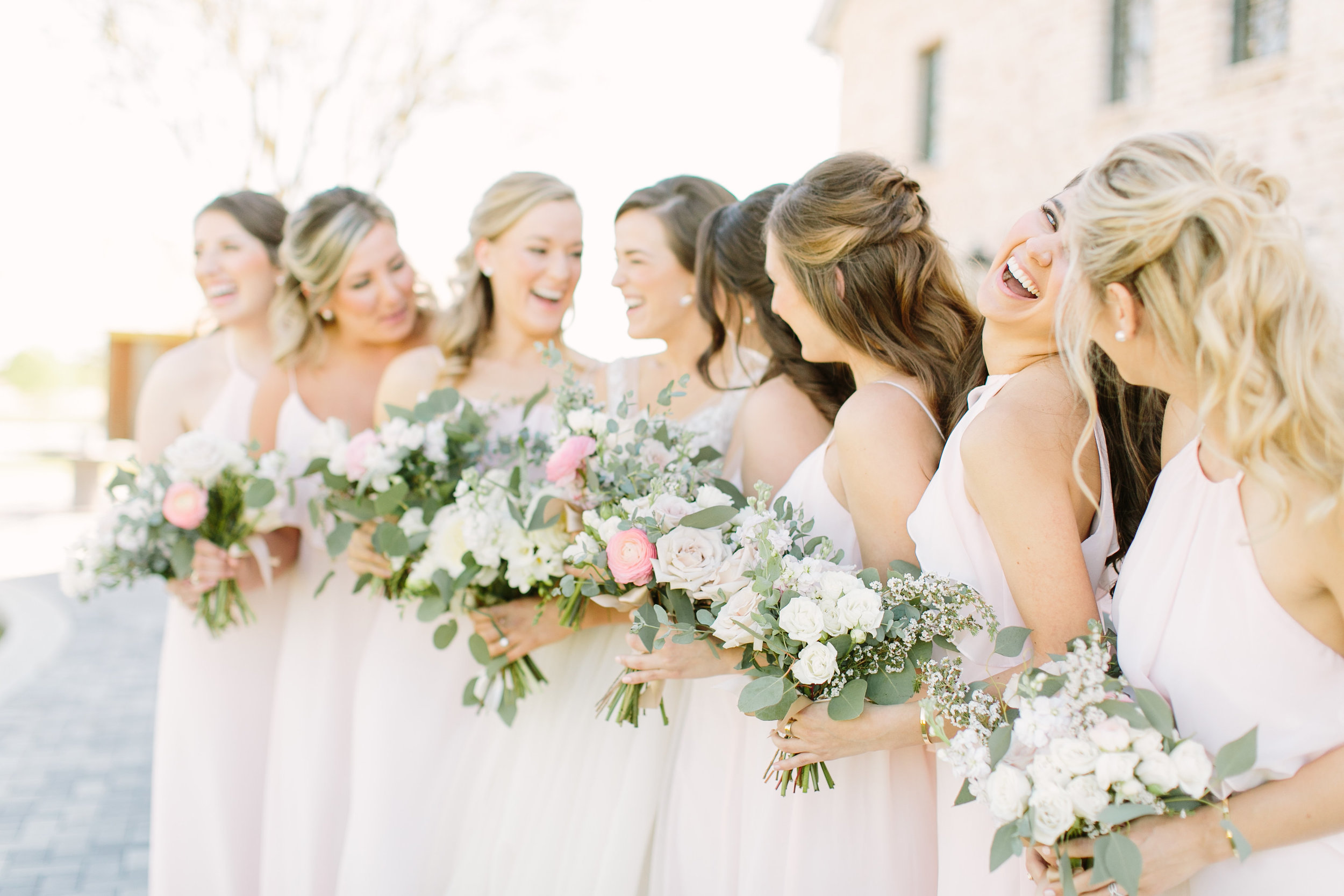 bridesmaids in blush dresses with bouquets by maxit flower design in houston texas