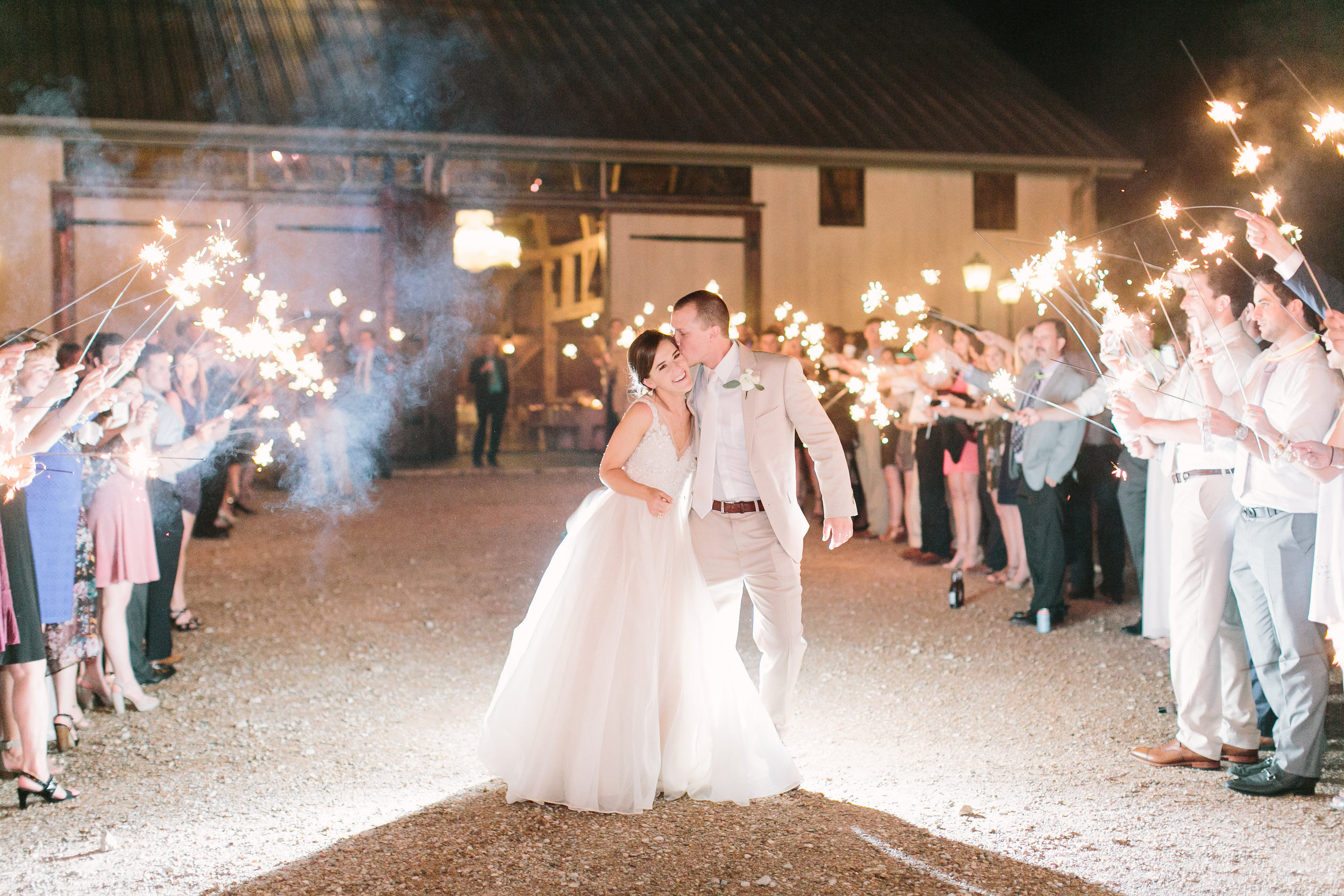 newlyweds with sparklers in katy texas